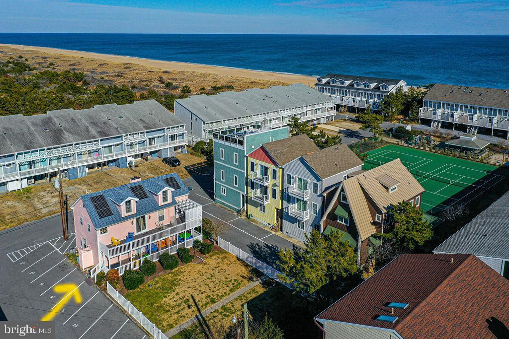Major Price Reduction on this beautiful ocean block beach house in North Bethany Beach, DE offers a generous 2,261 sq. ft. floor plan with 4 bedrooms and 2.1 bathrooms. The welcoming front door is on a spacious porch which is ideal for outdoor entertaining. The first floor has a grand foyer that doubles as a dining area, an oversized living room with hardwood floors, efficient kitchen with granite countertops, and a primary bedroom and bath. On the second floor you will find an additional recreational area, sunroom, outdoor sun deck, and two bedrooms with a Jack and Jill bath. The top floor has an expansive bedroom space and a half bath. Natural light flows to the living areas through a wall of windows and glass sliders from the sun deck. Relax in comfort both inside and outdoors. Lots of outdoor deck space and an outdoor shower. Fun times can be had by all at the community beach maintained by the Tower Shores Beach Association. New roof in 2019. Excellent rental income potential. Low Ground Rent fee of $1,471 annually which is auto-renewed and has 61 years remaining.