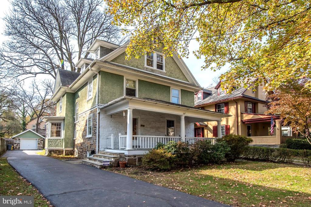 Welcome to 406 Bryn Mawr Avenue in Bala Cynwyd. This inspired 6 bedroom, 2 full bathroom/1 powder room home has been beautifully restored, maintaining the original character and charm of an older home while providing many of the modern updates today's buyers are looking for. Large rooms, architectural details, attentive craftsmanship and original hardwood floors can be found throughout. An inviting front porch flows into the living room featuring a fireplace with brick surround and wood mantle. The spacious dining room has a beautiful bay window and high ceilings, and flows to the chef's kitchen, creating an ideal space for entertaining. The eat-in kitchen includes Italian tile flooring with radiant heat, an 8-burner Wolf range/oven with hood and double oven, Sub-Zero refrigerator, custom wood cabinets/pantry/built-in desk, and abundant granite countertops. All eyes will follow into the step down Great Room that has exposed wood beams, a vaulted ceiling, radiant flooring, and walls of windows that flood the room with natural light and French doors that open up to the back patio and yard. A powder room completes the first floor. The second floor includes a master bedroom, outfitted with both a ladies closet and a gentleman's custom built-in closet. Two additional graciously-sized bedrooms and a large spa bathroom complete the second floor. The completely updated 5-piece bathroom offers both function and luxury with the French -inspired double marble vanity, heated Carerra marble floor, glass-enclosed shower with 3 shower heads, Jacuzzi tub, and French nickel hardware. The third floor includes three spacious bedrooms and a full hall bathroom. The third floor suite makes a perfect private retreat for the au-pair, or growing teenager. This can also be an ideal space to set up separate offices for individuals who may work from home. The unfinished lower level includes the laundry area and plenty of storage room. The flat backyard with patio, detached 1-car garage and driveway with ample parking complete this truly move-in ready home. This wonderful home is located in the award-winning Lower Merion School District, within blocks of the Cynwyd Train Station and Cynwyd Heritage Trail, and several houses of worship. Easy access to Center City, major roadways, public transportation, parks, dining, and entertainment.