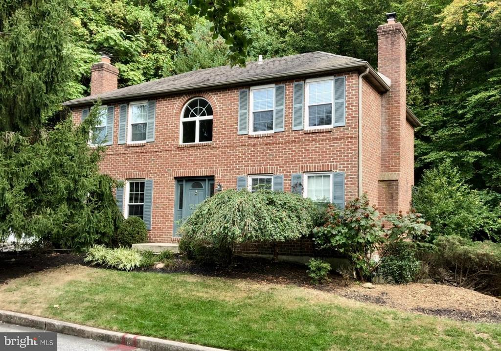 Location, Location, Location - You must check out this solid brick home located on a quiet cul de sac of just 9 homes! This charming, updated home is in the most prime location for shopping, restaurants and transportation. Just minutes to the Town of Wayne, King of Prussia Mall and King of Prussia Town Center (Wegmans!) and the major arteries of Rt. 202, PA Turnpike and the 422 corridor. The sun drenched 2 story Foyer gives you a taste what's to come. The first floor with it's newer Kitchen and adjacent breakfast area is the heart of this home, the Living Room and Dining Room each have fireplaces and there is lovely mill work and hardwood flooring throughout. The Living Room, with French doors leading to a landscaped, private rear yard, is expansive with space for relaxing and space for an Office. The first floor also includes a Powder Room. The second floor has an oversized Master Bedroom Suite with Dressing Room and newer Bath, 2 additional Bedrooms, Hall Bath and Laundry area. The Walk-out finished lower level is amazing with a gym, bar and large Family Room area with access to the yard. The serene backyard features a deck with pergola and a patio surrounded by 11 acres of wooded common grounds, walking trails and a babbling brook. Situated on a lush, private and professionally landscaped lot, this is the ultimate home for carefree living as the HOA takes care of landscaping, trash, water, snow removal and common area maintenance. With Low Taxes, low HOA fees and Low Maintenance who could ask for anything more?