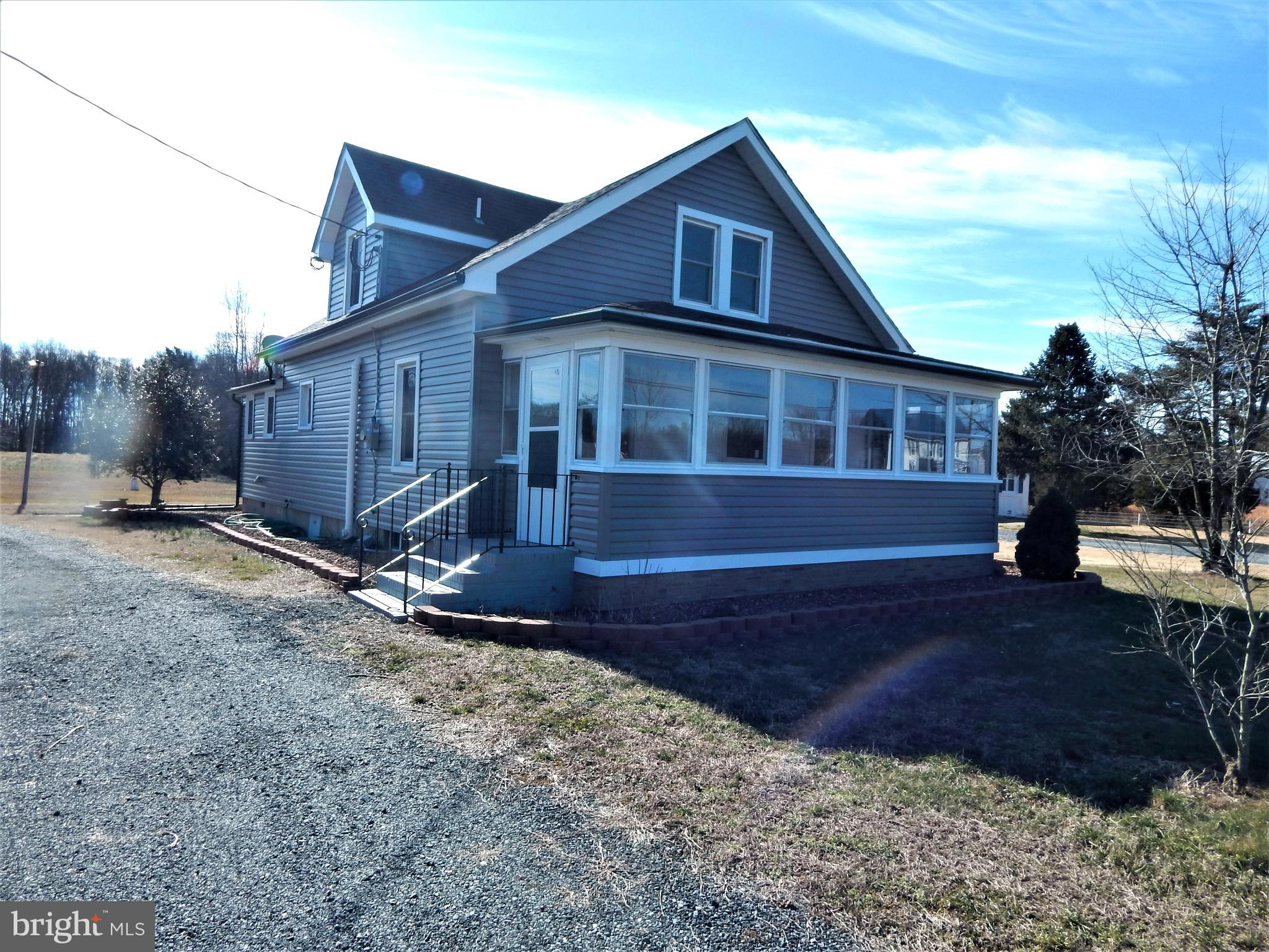 If a large, 40 x 38 concrete block garage is what you are looking for, this could be the one!  3 Bedrooms, 2 bathrooms, older Cape Cod, totally renovated, sitting on 1.3 acres is ready for a new owner. Anyone looking to be close to Maryland, this house is only 35 minutes to the Bay Bridge!
