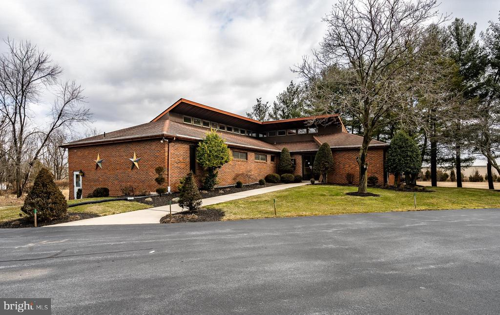 This is an exceptional opportunity to own a turn-key, well-maintained commercial property on a heavily-traveled road that offers high visibility for a variety of businesses.  The current configuration of this 4,000 sq foot building includes 2000 sq ft on the main floor with a large waiting area filled with lots of natural light, 7 exam rooms, 2 offices, a reception area, an X-ray Room, a dark room and 4 half-bathrooms. The 2,000 sq foot lower level has 2 half-bathrooms and 2 separate expansive office units that could be leased out because they each have their own individual entrances/exits. The building has 3 new HVAC units.  Check the township zoning for multiple uses of this commercial real estate.