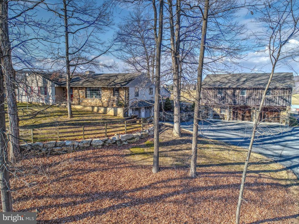 Beautiful 4.8 Acre Horse Farmette in Elverson!  Located near the Lancaster County line, 9 miles from Ludwigs Corner for the competitive horseman, 1/2 hour drive to Dressage at Devon, 5 miles to the Wyndsor Equestrian Center, and state game lands.  The walk through 5 stall barn offers a heated tack room, wash stall, four 12 x 12 stalls and a 12 x 14 brood mare stall, grain room and loft above for an abundance of hay/straw storage.  Stalls have rubber mats and heated automatic electric waterers!  Barn doors lead out to 3 fenced pastures, one with a frost free waterer.  But there is so much more!  When you pull into the driveway, you have a 10 year old 1344 sq. ft. bank barn for toys and equipment.  The stone is real Chester County stone.  Above the barn is a 1260 sq. ft. 2 bedroom apartment/in-law suite 2 years new!  The apartment offers ceramic tile floor in the kitchen and dining area, granite counter tops and tile backsplash, sliding glass doors leading to a Trex wrap around deck, laundry room (W&D stay) and full bath.  Nothing has been spared in the quality and design of this apartment.  It had been rented for $1300/month.  The apartment has it's own septic and electric service but shares the well with the main home.  Your home is a 3 bedroom rancher with a large kitchen with custom made island, granite counter top, 5 burner stove top, 6 high back chairs, and small veggie sink.  The kitchen itself offers granite counter tops with double ovens and warmer drawer, antique stained glass in one of your lighted built-in cabinets, wine refrigerator, double sink, built-in microwave drawer and cabinet-wrapped dishwasher.  Ceramic tile floor is heated.  Cabinets are cherry.  The sunken dining room has hardwood floors and well lit tray ceiling.  The family room has real Chester County stone fireplace which has been converted from wood to propane.  Your mantle was cut and designed from a tree on the property.  The mud room has heated ceramic tile floor, sink, washer and dryer