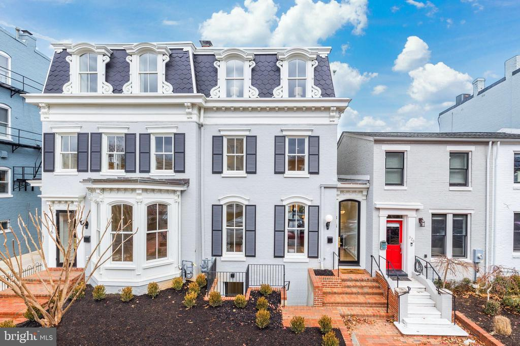 Created by Brush Arbor Home Construction's masterful collaboration of architects, interior designers, and landscape architects, this total renovation of one of Frederick Douglass' former residences is a four-level Second Empire-style townhouse of impeccable elegance and exceptional scale. Providing bespoke tranquility in a coveted location just a couple blocks from the Supreme Court, Capitol and Senate Buildings, no detail has been overlooked in the custom renovation of this architectural gem.  Here, luxury and sophistication clearly meet modern day amenities and lifestyle needs.    A spectacular open floor plan integrates 10' ceilings, elevator shaft, custom interior and exterior millwork, hand-milled white oak floors, Jeld Wen windows and doors, fixtures by Kallista and waterworks, and designer bespoke finishes such as lighting by Visual Comfort; all provide breadth and airiness on the main level. There is a seamless flow from indoors to outdoors from a custom 15-foot wall of retractable doors opens to the rear patio and garden, capturing an abundance of natural light adjacent to the chef's kitchen with its rigorously curated appliance package.    The well-appointed primary bedroom is on the third level, with spa-inspired bathroom, walk-in closets, large sitting room with wet bar and private roof terrace. All five secondary bedrooms, spread across the second level and the lower level echo the primary's luxury finishes and closet space. The exceptionally crafted lower level's family room with built-ins, bonus bedrooms and access to the garden from the lower level provide excellent flexibility for au-pair or in-law living configurations. The exterior has been planned with the utmost discernment, executed to provide a private backyard retreat which features a stone patio, shaded by strategically chosen, well-placed greenery, with both a single car and a 2-car garage (totaling three parking spaces)..