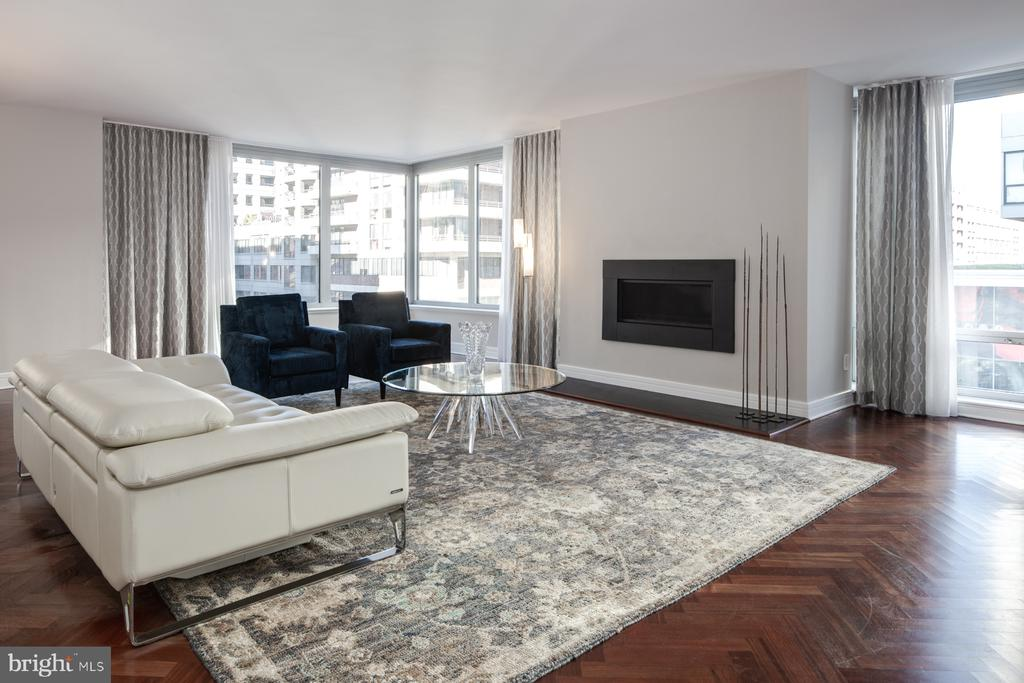Among the most desired floorplans in all of the Ritz-Carlton, a corner unit exceeding 2,800 square feet, wrapped with windows, and all on one level. The sellers have improved every inch of the home, from the new kitchen that is perfect, with marble surfaces, sub-zero and wolf appliances, brilliant lighting, and all-new cabinetry. All three bathrooms and the powder-room were completely remodeled with white marble, Waterworks fixtures, Robern mirrors, and a stunning new main-suite with a gorgeous glass shower and freestanding soaking tub. They have refinished all of the cherry hardwood floorings with a satin walnut stain and added luxurious carpeting in the bedrooms. Even the HVAC system and washer/dryer are brand-new. Finally, there was careful attention to subtle layout changes that have drastically improved the comfort of the living arrangement. The Ritz-Carlton Residences live up to the reputation, synonymous with the celebrated brand. The building includes 24-hour concierge service, doormen, valet parking, and in-residence dining. Centrally located in the very popular West End neighborhood, the building is surrounded by fine dining and retail, with fantastic walkability to Trader Joe's, Whole Foods, parks, Downtown, and Georgetown. This is the finest residence available in the West-End today, and at the most competitive price.