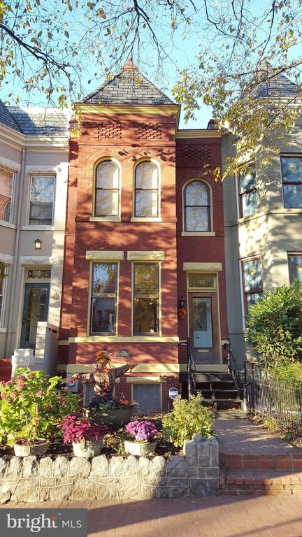 Lovingly restored and renovated Victorian beauty perfectly located right in the heart of Capitol Hill! Includes all the modern conveniences of today while preserving all of its original charm. This lovely home includes ornate, elegant woodwork throughout, a beautiful living room fireplace framed with a gorgeous wood mantle and glass tile, tons of built-ins, a fabulous gourmet chef's kitchen with top of the line appliances and flooded with light, bay window, a main level powder room, three bedrooms and two baths upstairs including primary bedroom with private bath, hall bath with Victorian claw-foot tub, and a deck off the rear bedroom. Solar Panels convey! A  fully finished basement with a rear entrance and it's own full kitchen and full bath can be a fully functional in-law suite or extra level of living! The basement has been used as a fourth bedroom.  And all of this supplemented by a large rear deck, a lovely rear flagstone patio and a detached garage! Perfectly located on a lovely block with wide brick sidewalks, this home is just half a block to Lincoln Park, and an easy stroll to restaurants, shopping and metro at Eastern Market! Also very convenient to the Capitol, the Supreme Court, the National Mall and Union Station.     Legal: 1014//0026 Property taxes in 2020: $8930 Year Built: 1908