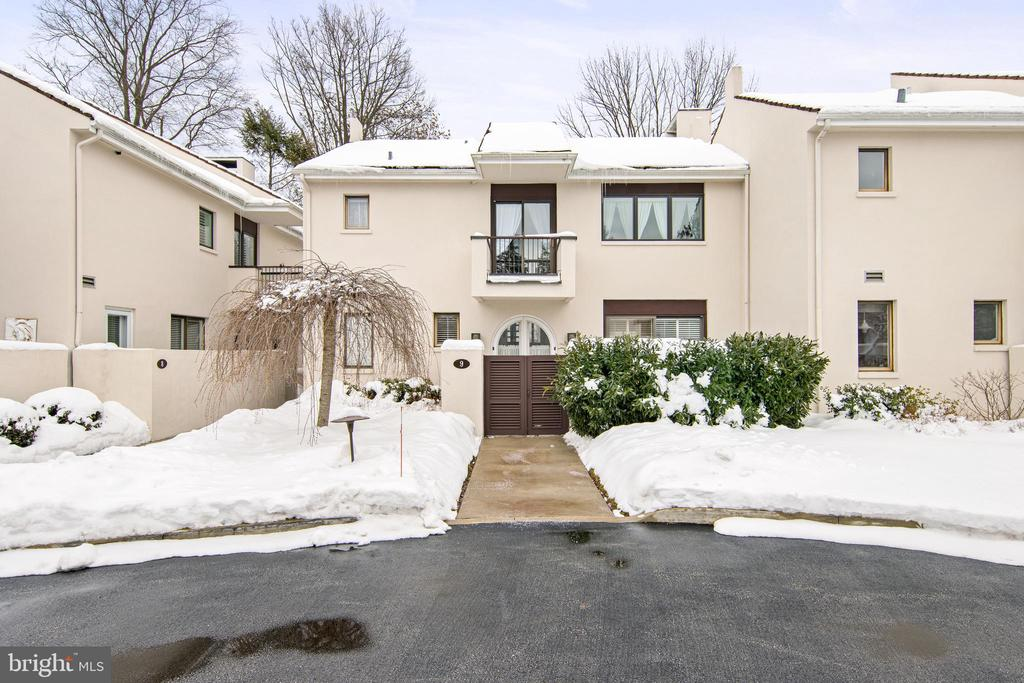 Welcome to 9 Brettagne located in the prestigious Arbordeau community. Flooded with natural light, this Arbordeau  3 bed 2 1/2 bath town home is perfectly located to catch lots of natural light. Enter into a private and beautifully Mediterranean landscaped courtyard, with flag stone and space to sit and enjoy the sunshine. 9 Brettagne is accessed through double glass doors into a foyer with powder room and closet, Brazilian hardwood floors flow throughout the main floor.  To your right is a large living room with plantation shutters with a wood fireplace, the kitchen with sub-zero refrigerator and other stainless steel appliances and breakfast nook is to the left of the entry foyer, with a pocket door to the dining area. Open stairs rise to the second floor allowing all that natural light to bathe the home. The large main bedroom suite is at the top of the stairs with double closets and an updated en suite bathroom with double sinks and walk in shower, a small balcony overlooking the courtyard can be accessed from the bedroom. Two other bedrooms, the first with pull down access to the attic area and one currently being used as a craft room and a second updated hall bath with walk in shower are on this level as well. The lower level has a large family room, and storage and utility area. Updated panel. Underground garage with two spaces can be accessed through a private entrance with mud room area, no reason to get wet or cold getting to your car. Clubhouse and community swimming pool available for use. Arbordeau is perfectly located on the main line, and has the added security of being a gated secure community. Minutes to everywhere important on the Main Line and a short distance from Jenkins Arboretum, Devon or Berwyn Stations. Plentiful supply of excellent restaurants, shops and bars are nearby.