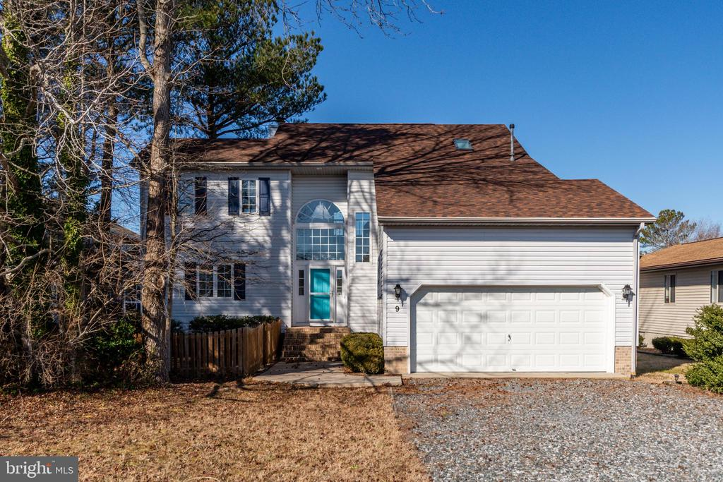 This is the perfect waterfront home in Ocean Pines. Just minutes to the open bay no bridges to go under. Nice size lot with a fence for the pups. Lots of outdoor living space 2 decks and a screened in porch. This beautiful 4 bedroom and 2.5 bath home has had lots of updates: new kitchen, new carpet,  roof in 2012 with a  30 year Architectural  shingle, gutter guards, new windows: kitchen, laundry and master bedroom, pier replaced in 2017, hot water heater replaced in 2017. The views from this property are spectacular you look directly down the canal nothing obstruction your water view. Ocean pines has lots of amenities: outdoor and indoor pools, marina, yacht club, parks, private beach club and so much more!