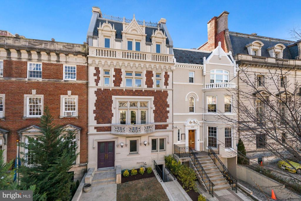 Magnificent Embassy Row mansion spanning over 9,600 square feet of unparalleled finish and design. Built in 1907, this five  story Beaux Arts townhouse was originally designed by renowned architect George Totten with classic Kalorama entertaining floors. Recently renovated by acclaimed architect Christian Zapatka to modernize elements but maintained its original elegant character. The house features include an elevator, ornate moldings, multiple fireplaces, impressive ceiling height, large scale rooms and staff quarters. The first level includes a gracious foyer, parlor, dual sitting rooms, office/ sunroom that accesses a rear outdoor terrace, and a powder room.  The second level features a spacious living room with views of Embassy Row, gallery, formal dining room, kitchen and powder room. The third level includes a deluxe primary suite with a sitting room, luxurious bath with his and hers sinks, soaking tub and walk-in shower, large dressing room, and an additional bedroom suite. The fourth floor has two bedroom suites, kitchenette and laundry room. The lower level has a wine cellar, exercise room, multiple storage rooms and a full bath. Diplomatic zoning overlay.