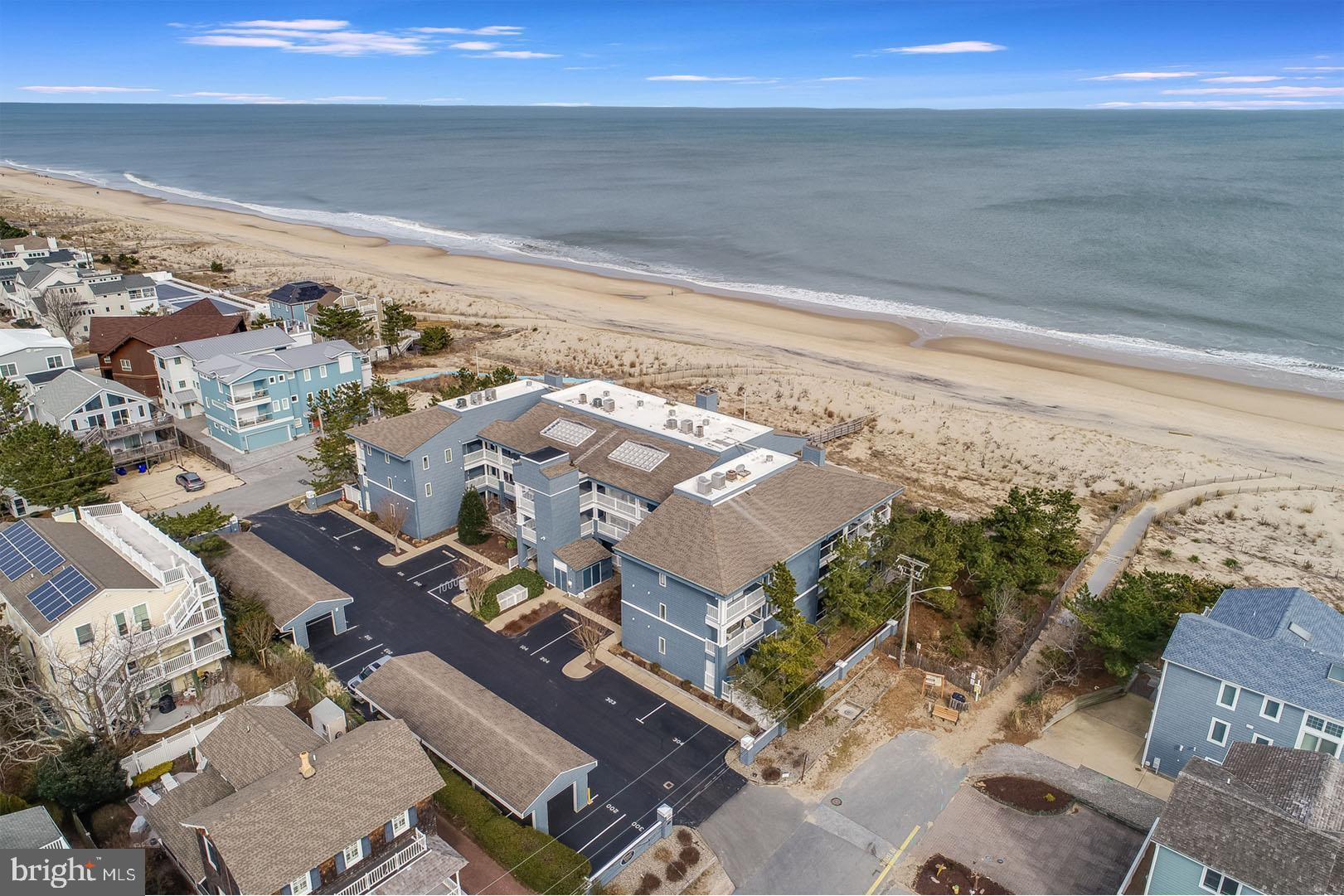 Welcome to Unit 204 in Wilson Dunes, a rare oceanfront opportunity in the pristinely maintained and highly desired boutique style 12-unit luxury condo building. From the moment you enter, you will be captivated by the spectacular ocean views. This 2nd level unit is in the southeast corner of the building and offers an abundance of natural light from its southern exposure and remarkable sunrises. This property features low maintenance living at its absolute finest. Recent complex updates include new exterior siding, new deck surfaces for all 2nd and 3rd floor units, new beach walk offering private access to the beach, and updated walkways and composite decking. This condo has never been rented and undergone numerous updates and renovations in recent years including new flooring throughout, new paint, updated hall bathroom, new Pella door units, hurricane shutters and recessed lighting. The property features 3 spacious bedrooms, 2.5 baths, private laundry, beautifully appointed kitchen with space for both indoor and outdoor dining and a large breakfast bar that comfortably seats at least 5. Floor to ceiling sliders encompass the entire living space casting the ocean and sand as your natural backdrop. Wilson Dunes offers the utmost convenient location just steps to the beach, bay and the amenities of Dewey Beach. In addition, only a quick walk, bike ride or trolley ride from downtown Rehoboth. Being sold mostly furnished, this opportunity is move in ready and awaiting your enjoyment for the 2021 summer season!