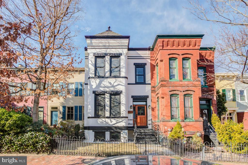 Stunning Capitol Hill Renovation! 4 BR, 3.5 BA in the main house & a 1BR, 1 BA studio above the garage - current DC use-code 015 Residential-Mixed Use. Perfectly located in sought after Capitol Hill within walking distance to dynamic H Street NE as well as Union Station's Metro and commuter rail lines. All finishes and systems are new throughout the home and carriage house, including plumbing, electrical, windows, doors as well as the roof. Spacious open floor plan with wide-plank, Aspen Hill flooring & distinctive architectural features. Gorgeous gourmet kitchen w/ stainless steel Viking gas range, refrigerator and dishwasher, Bosch 2nd wall oven & built-in microwave. All new cabinetry & lighting complimented by quartz countertops with an elegantly designed breakfast bar. A walk-in pantry. French doors open to the rear flagstone patio and garden with new fencing. detached, two-car garage has been fully renovated with a studio on the second level – perfect for guests or as an in-law suite. Striking exposed brick wall begins on the main level and continues up the stairs to the second level. Luxurious owner's suite w/ private bathroom, extensive walk-in closet & bay window sitting area. Ensuite bathroom w/ marble dual-sink vanity and marble flooring. 2nd floor laundry closet with washer & dryer.   Versital Lower Level/guest suite  w/wet bar - quartz counters, microwave & mini- fridge. Fourth bedroom with a large closet - this flexible room could be used as an office, home gym or mud room Lower level laundry with washer/dryer. The lower level has a rear, exterior door in addition to the inside connecting stairway. Fully updated the detached garage easily fits two cars. The second level has been beautifully renovated as a studio with a private entrance. The studio features the same wide-plank Aspen Hill flooring found in the main home. The kitchenette boasts quartz counters, abundant cabinetry, a mini-fridge and microwave. The full bathroom is elegantly done with a marble vanity and flooring as well as marble flooring in the walk-in shower. The bedroom area is spacious with a large closet.