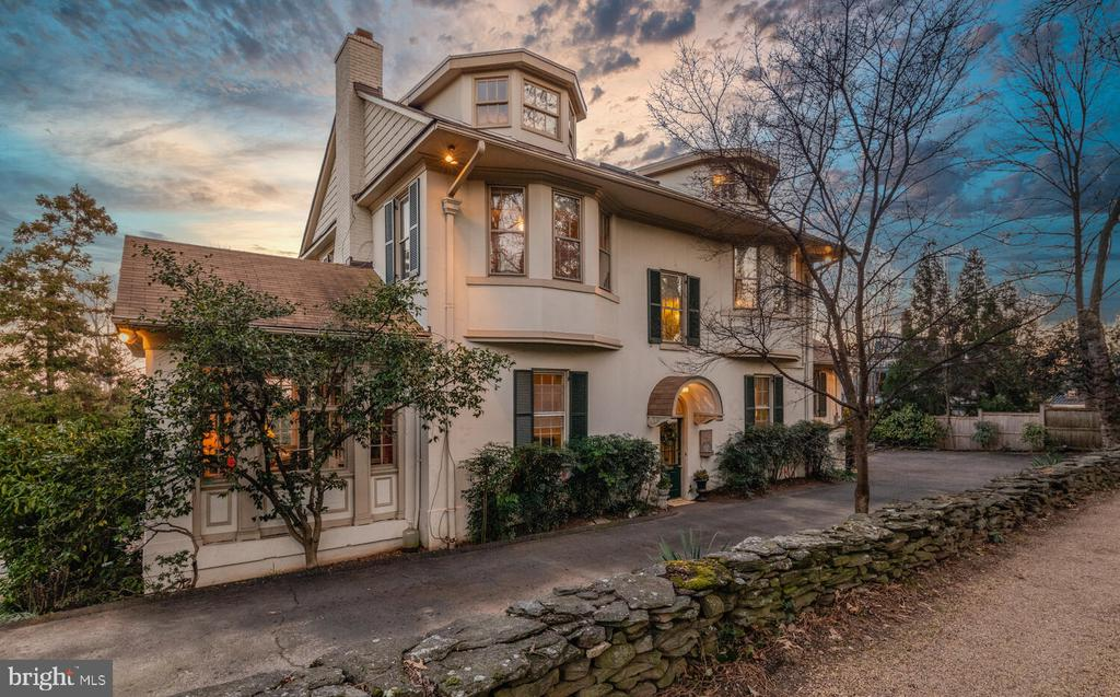 1918 architectural gem by Kalorama-famous architect Waddy B. Wood available for only the third time in the past 80 years. Expansive 0.55 acres is inclusive of terraced gardens, outdoor lounging/dining, and an exquisite botanical collection of hardy, flowering and rare plants/trees. Classic Washington style in stucco with soaring 10' ceilings, sunny 8' French doors, stunning and NEW kitchen renovation, 5 bedrooms, 3.5 bathrooms, finished/walk-out basement, and detached 2-car garage. Historians right at home with Dolley Madison-owned mantel, library with built-ins, century-old grandeur in moldings, chandelier, and strategic placement of doors to enhance natural airflow. Luxuriate in a master suite with renovated bath and romantic Juliet balcony. Historic Washington is yours to own in this city-adjacent estate with premier privacy atop a ridge. --MORE DETAILS COMING SOON! SHOWINGS CAN BEGIN 3/1. - WATCH VIDEO TOUR NOW!
