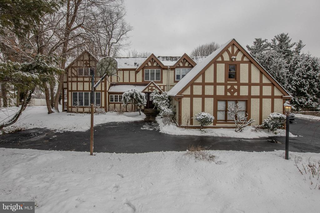 An opportunity to own an historic Tudor Home on Lower Merion.  The present owners have done extensive alterations and rennovations since purchasing it in 1985.  French doors  illuminate the interior.Original stone pillars are a reminder of it's history.  The rooms are large with high ceilings in some of the rooms.  There are lots of closet and counter space.  The first floor has a very large eat in kitchen with a  large island that has storage, sink, wine refrigerator, and space for seating. Adjoining family room has a fireplace a, built-ins  and sliding doors to outside. Large dining room and a living room with a fireplace. There is a small den and powder room as well . There is also an extra room with an exit door and a space with plumbing.attached 2 car garage. Five bedrooms, 3 full baths, laundry room, built-ins, walk in closets complete the second floor.  This home is on a cul-de-sac.  It combines history of an old home with modern ingenuity. Gardner  Fox  completed additions on the home which included relocating the kitchen and creating the  new space , adding master bed and bath ,adding living room and garage.