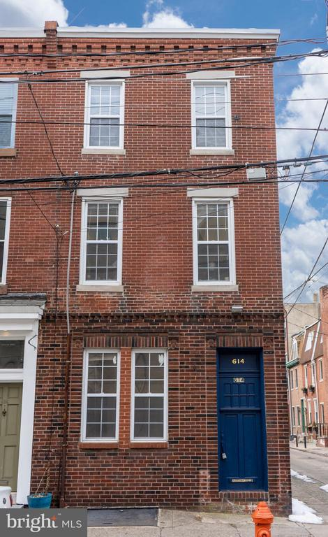 Fantastic fully leased three-story corner Triplex located one-half block off of 6th & South Streets in the heart of Queen Village! The bright, sunny 1st-floor apartment was recently renovated with a new kitchen and bathroom, and hardwood floors throughout. This unit has access to a small rear yard with parking possible. The bi-level 2nd/3rd-floor front apartment opens to a spacious living room, plenty of room for a desk, and a full kitchen with a dishwasher. The open staircase leads to a spacious sunny bedroom with great closet space and access to an updated bathroom. Another 1 bedroom/1 Bathroom bi-level apartment is positioned at the rear of the 2nd/3rd Floor. Features include hardwood floors, an open kitchen with a dishwasher, and a breakfast bar. A staircase leads upstairs to a large bedroom with a walk-in closet and a bathroom with a spacious shower area. All units feature central air, private laundry, and have separately metered gas and electricity. Great location with easy access to Center City, Society Hill, Queens Village, and South Philadelphia.