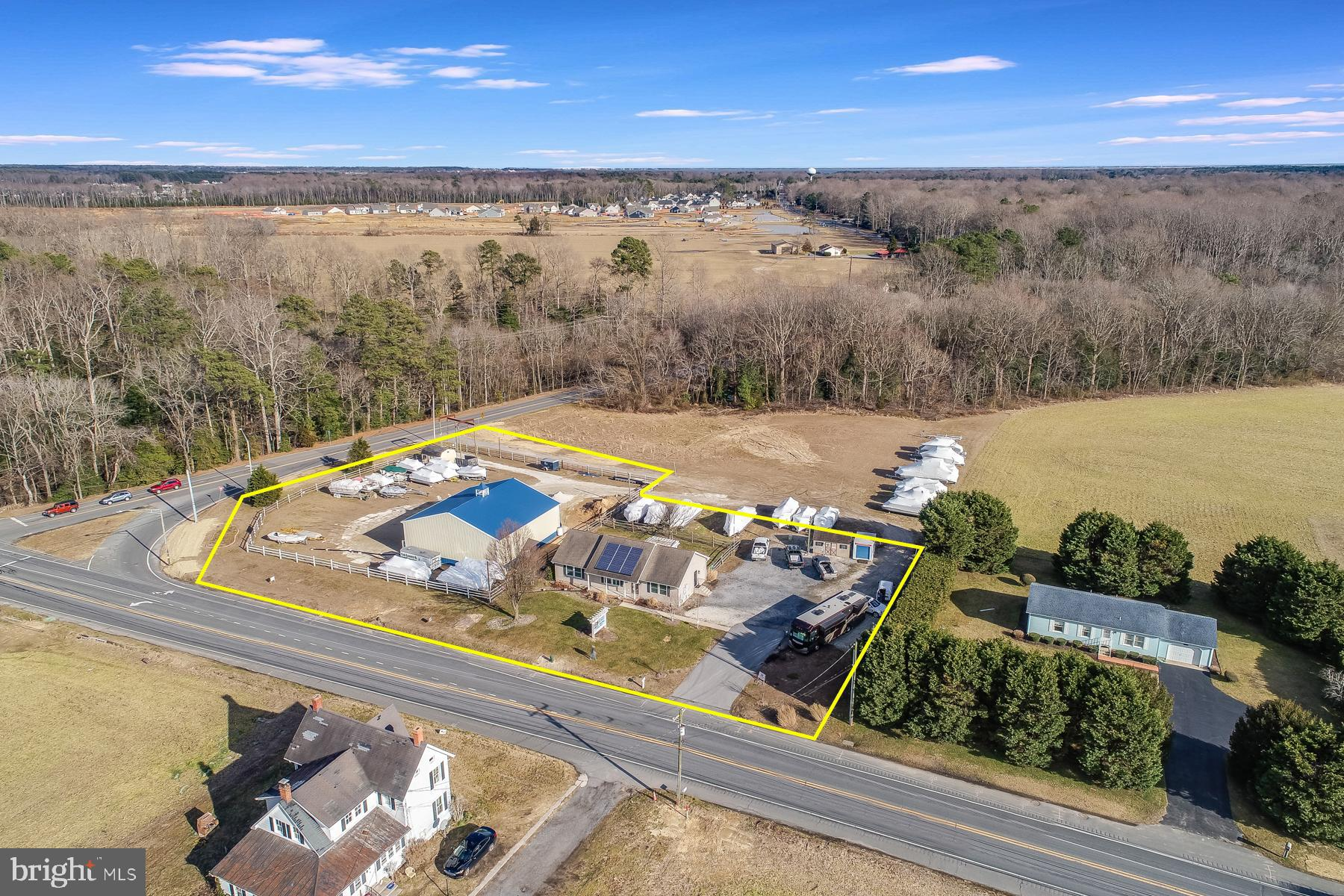 Rare Opportunity - approximately 1.5 acres zoned for conditional use at corner of John J. Williams Highway and Angola Road in Lewes!  Home or office located on 1/2 acre parcel features 3 bedrooms, 2 baths, hardwood flooring, solar panels, back deck, & more.  1 Acre parcel next door has a 50 x 50 pole barn.  1.5 acres is zoned AR-1 but has conditional use to operate businesses related to grass cutting, power washing, marine services and sales, and construction services.   Many opportunities to work from home, operate your business, or seek commercial zoning for another use!