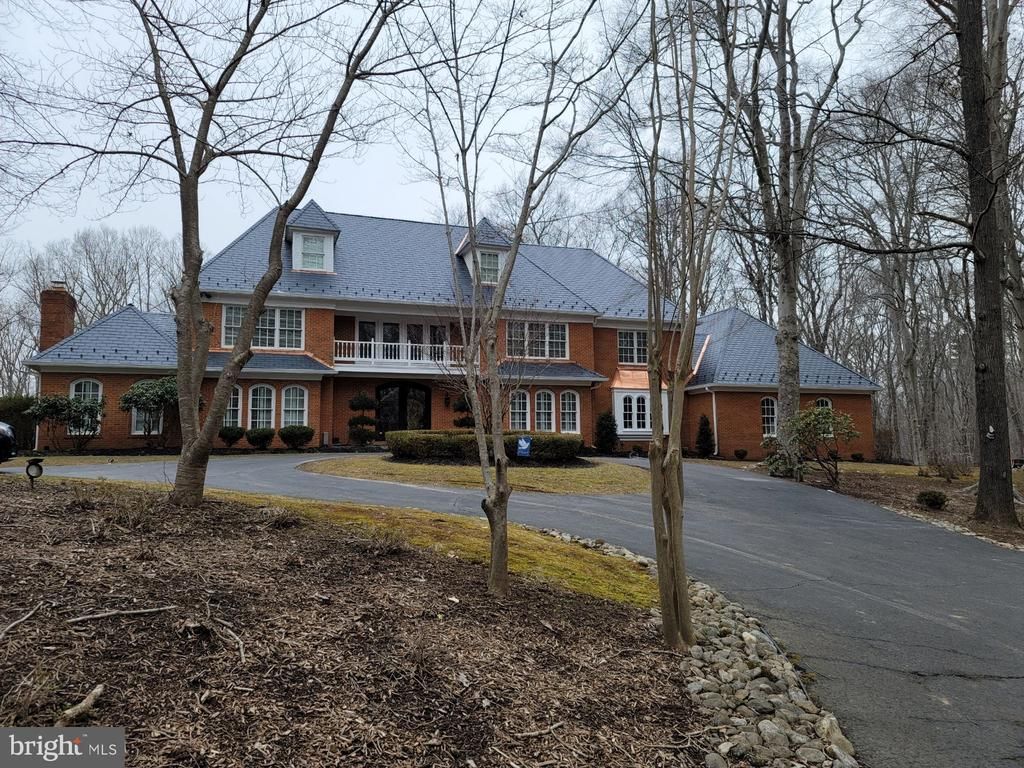 Magnificent 4-level 7BR/5.5BA custom brick estate home on 5 wooded acres w/ $500k + custom back yard pool & huge deck w/ outdoor kitchen! Brand new engineered slate roof w/ copper flashing! New HVACs w/ Air Scrubber! Located in prestigious Wyckland, this quality custom home features large rooms w/ a wonderful flow through the main level including a grand 2-story entrance! Multiple wood burning fireplaces throughout the house! Main floor office, full BR & full BA! Granite eat-in kitchen w/ gas cooking & stainless steel appliances! Master suite w/ sitting room & wood burning fireplace, double vanities, jetted tub & stall shower! Large secondary BRs! Finished 4th level w/ rec/bed room, high ceilings, full bath & additional storage! Finished basement w/ wet bar, steam shower & wine cellar! Oversized 3 car garage can accommodate more! So many custom details that you must see to believe! Call today for your private showing!