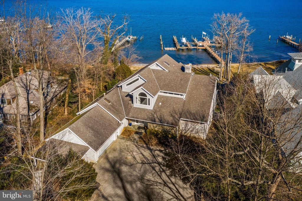ONE OF THE MOST UNIQUE AND ICONIC WATERFRONT PROPERTIES IN THE ENTIRE ANNAPOLIS AREA. FABULOUS CUSTOM BUILT CONTEMPORARY WITH SOARING CEILINGS AND WALLS OF PICTURE WINDOWS OVERLOOKING THE SEVERN RIVER WITH SPECTACULAR BREATHTAKING VIEWS. THREE PIERS GRANDFATHERED WITH THE PROPERTY THAT CAN BE RARELY FOUND INCLUDE THE ABILITY TO HOUSE A 65 FOOT BOAT WITH 6 FOOT DEPTHS.   A FULL SIZED HEATED POOL IS SET INTO THE LANDSCAPE WITH FULL WATERFRONT EXPOSURE. FURTHER ENHANCING THIS ONE OF A KIND PROPERTY IS A PRIVATE BEACH. CONTACT LISTER FOR MORE DETAILS ABOUT THIS TRULY INCREDIBLE PROPERTY WHICH PRESENTS A ONCE IN A LIFETIME OPPORTUNITY FOR ITS FUTURE OWNER.
