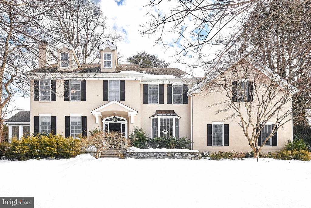 """Look no further. This stunning residence offers absolute perfection to the next lucky owners and is located in a highly coveted """"walk to everything"""" cul-de sac neighborhood in North -side Bryn Mawr. Move right into this designer showcase of a home featuring sun-filled rooms with 9' ceilings, open floor plan, tone on tone decor, beautifully crafted modern finishes, site finished oak floors, fabulous lighting throughout, inviting living and dining rooms, recently renovated and expanded gourmet kitchen with creamy cabinets, marble countertops, walk in pantry and top of the line appliances, french door from breakfast table are leads out to private terrace complete with a built-in firepit, impressive family room with a wall of windows featuring peaceful views, incredible sun room/ office with 3 walls of windows, luxurious master suite with trayed ceiling, bright windows, neutral decor, custom built-ins and lighting, separate sitting room/ office spacious walk-in dressing room with custom shelving and center island ,  beautifully renovated bathroom with radiant floors, frameless glass shower, soaking tub and his and hers marble vanities, second floor laundry, 3 additional large bedrooms, one with an en-suite white tiled bath and the other two sharing a generously sized white- tiled Jack and Jill bathroom, and a recently finished lower level with optional 5th bedroom/bonus  space, finished media/ game room with projection TV and screen, exercise room and custom-tiled full bathroom. The quiet location at the end of the cul-de sac is within 5 minutes walking distance to Bryn Mawr's renowned schools, train, restaurants and shopping. This one won't last long!  *SHOWINGS BEGIN AT OPEN HOUSE ON 2/20 from 12-4pm* Masks, gloves and Covid forms are required for entry on all showings and open houses."""