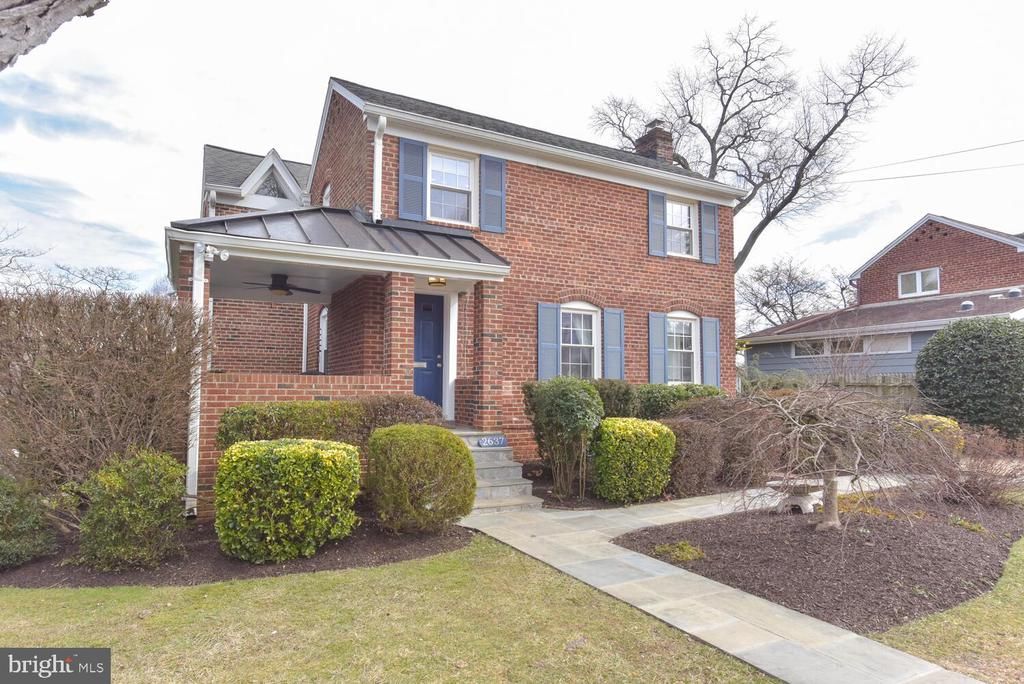 "House Beautiful! Gorgeous & EXPANDED Brick Colonial! Nearly 2300 finished square feet on (3) Three Levels! All adjectives apply from curb to wrapping  front porch & into formal Living Room, Main Level Family Room & Dining Room (with dramatic 2 story bow window), Main level Den/Office, sundrenched Kitchen with breakfast space with hardwoods throughout. 3 generous sized upper level Bedrooms,  (Owner's Suite boasts dressing area & luxury bath suite).  Finished lower level recreation room with 3rd full bath. Professionally landscaped grounds, top schools all in walking distance -Discovery ES., Williamsburg MS., Yorktown HS)!  Short walking distance to shops at Harrison Street: Grocery, Restaurants, Convenience, and also Playgrounds!  'The Arlington Lifestyle!'  Great neighborhood feel, with block/community parties, High School Football ""Tailgates"", even Cookie Exchanges!! For those who want to be connected to neighbors Milburn Terrace offers some great options! All located Just a short distance to commuter routes and less than 2 miles to East Falls Church Metro!"