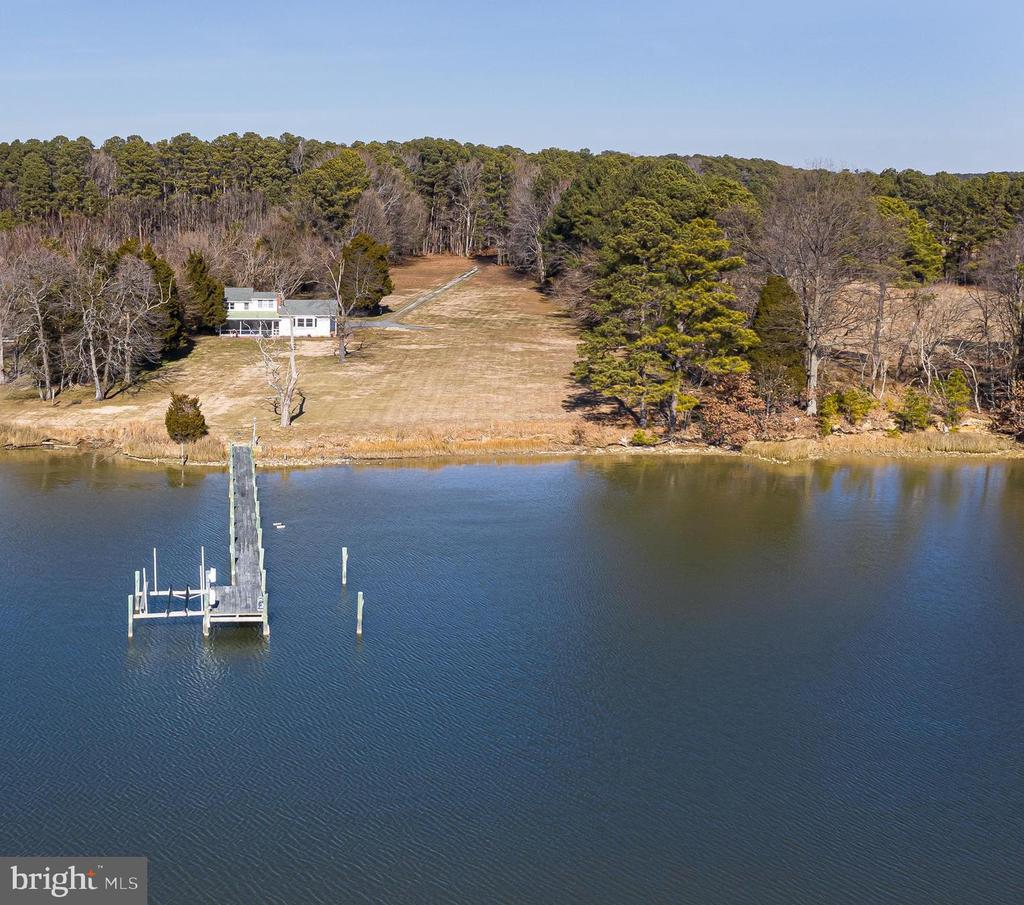 "Escape to the ""Costello Property"", a majestic 3.7 acre waterfront property with over 300 feet of water frontage on Leadenham Creek.  This enchanting waterfront cottage located in Bozman just 7 miles from the village of St Michaels is surrounded by water, shady trees and wildlife.  Enjoy glorious sunsets from this tranquil serene private setting.  The charming 3 bedroom, 3 bath home is totally turn-key with simple decor and wonderful access to water activities.  The private pier on the protected Bobby Owl Cove offers 5 ft water depth plus a boat lift, the perfect setup for the boating enthusiast.  The living room is cozy in winter months with a wood burning fireplace and water views.  One can dine outside either on the screened-in porch or the outside terrace during three seasons of the year.  There is a full laundry room and storage/mudroom with outside access.  An attached two-bay garage can double as storage for water toys and bikes.  The area offers great biking as well.  Alternatively, this site could also be a fabulous location to build a new custom home or property investment as it demonstrates an extremely successful Airbnb rental history (https://www.airbnb.com/rooms/16617423).  Just minutes down the road, one can enjoy fine dining in the historic village of St Michaels, interesting eclectic shops, sailboat cruises, or spend some time at the famous Chesapeake Bay Maritime Museum.  Easton and Oxford are also well worth exploring and they are just 25 minutes from the house.  Don't let this once in a lifetime opportunity slip away!"