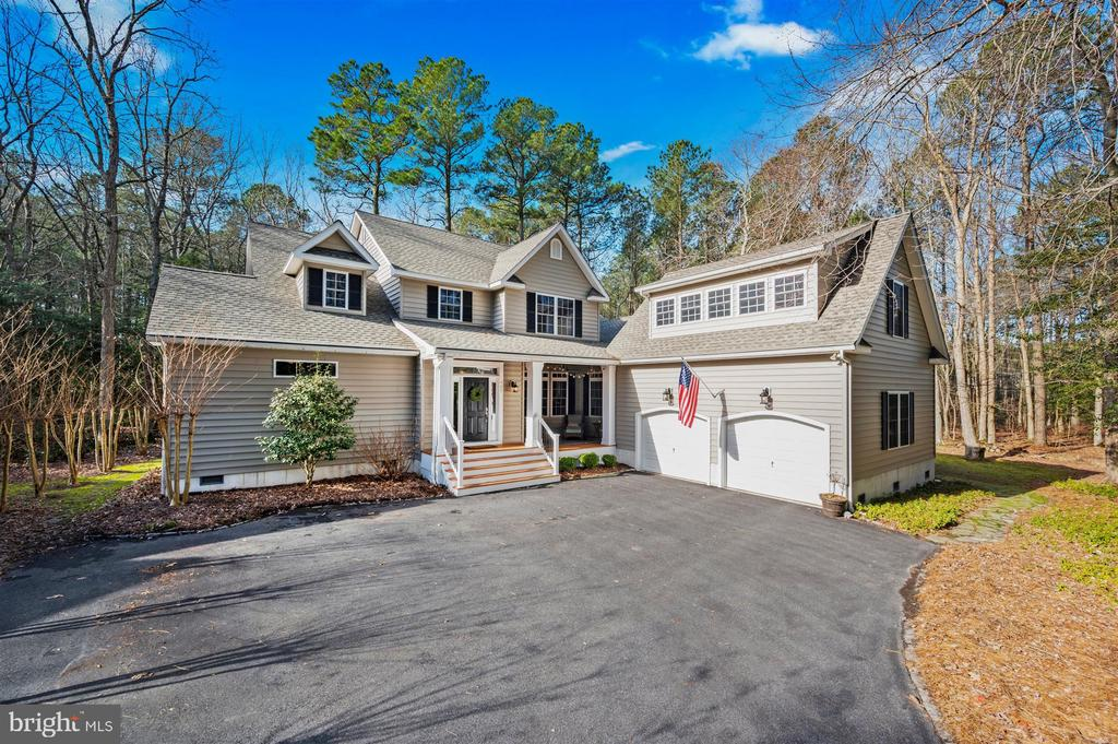 Every corner of this gorgeous home is graced with luxury and fine craftmanship! Traditional elegance greets you as you walk through the door and into the generous foyer.  The gourmet kitchen  will delight the chef within! Ample, beautiful Granite and Quartz countertops including an oversized island, compliment the space and gleaming stainless steel, upper end appliances provide everything you need in a kitchen and more.  Chill your wine in its own under counter fridge and enjoy the  abundance of cabinet space.  Cozy up to the warmth of one of three fireplaces in the lovely, southern styled Keeping Room off of the kitchen, serve your guest in the formal dining room or entertain in the living room also enjoying a cozy fireplace. Your sweeping master bedroom is full of light. The master bath has a marble, double sized shower, radiant heated floors and a private sauna. The upper level has two more bedroom suites, an exercise area and a sitting room. All bedrooms include custom organization, walk in closets.  AND you cannot overstate the awesomeness of the custom crafted entertainment room! Delight your guests or use as your own private hideaway.  The custom floored garage has a car lift for the car enthusiast!  Moving to the outside, you will find a fabulous extension of the home.  On an acre and a half, nestled in the trees, an outdoor living space with a big screen overlooking the fireplace and hot tub bring the fun to the outdoors. Must see to appreciate.  Call for your private tour!
