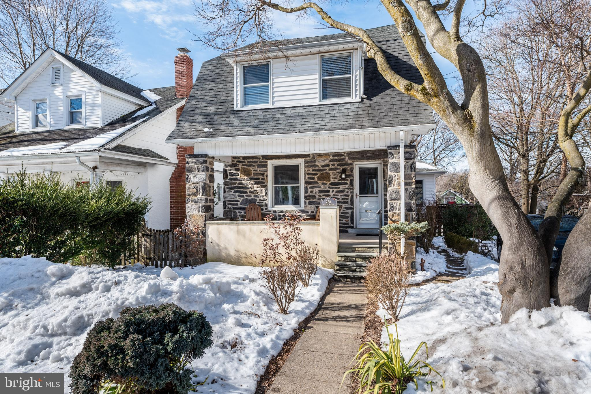 Welcome to this special Narberth home on one of the best blocks in the Borough. Narberths appeal is hard to overstate, with its walkability and movie theater, library, and public park, as well as easy access to Center City (the train station is just two blocks away). Walk to the Boroughs numerous independent businesses, including a grocer/deli shop, cheese shop, French pastry shop, and terrific pubs and restaurants. The warm, traditional street presence belies the great amount of space inside - with plenty of square footage to support work and education from home for all family members. And its location in Lower Merion - ranked #2 in the nation for living and working from home by Money magazine - is a true plus. Under the current boundaries in the highly rated Lower Merion School District, children attend Belmont Hills Elementary, Welsh Valley Middle School and have a choice of Lower Merion High School or Harriton High School. The covered porch opens into a large interior, and the expansive great room addition is secluded from the street. The combination living/dining room is spacious and sunny, with well-placed windows and gleaming wood floors with inlaid accent. The cheerful kitchen has white wood cabinets, stainless steel appliances, and custom tiled floor. There is an open half-wall to a true gem of this home: its open, step-down great room. The great room was added in 2006. It is over 500 square feet (23ft x 23ft) and is a wonderful gathering space with a soaring cathedral ceiling, beautiful gas fireplace, and dining area. The ten oversized Andersen windows truly let the sunshine stream in, and the ceiling fan and recessed lighting enhance the comfort and beauty of this multipurpose room. Walk out through Andersen French doors to the gorgeous 400 square foot (29 ft x 9 ft) deck (with new polywood boards) overlooking the bucolic yard. The great room and deck flow beautifully from the kitchen for entertaining. In addition, the long views to the west allow you to 