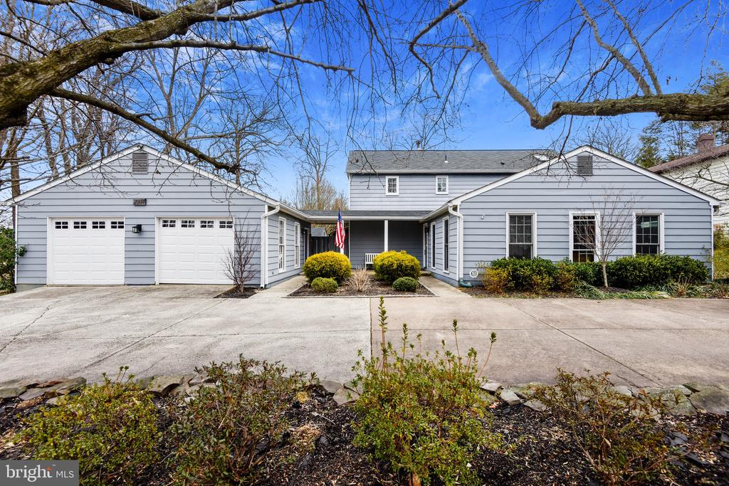 Thoughtfully planned, & meticulously renovated, this unique contemporary home is the perfect retreat. As you walk past the lovely front garden & through the front door, beautiful white oak, wide-planked, hardwood floors usher you in to the modern, open concept living area. Abundant natural light streams in from the many windows & kitchen skylight. The main level highlights include a large living & dining area, perfect for gatherings, a stunning, state-of-the-art, gourmet kitchen, featuring Eurostyle cabinets, Quartz countertops & backsplash, a freestanding Italian marble island, & a large peninsula with counter seating. Home chefs will relish the 36 inch, Wolf gas range, a Wolf 24 inch convection/steam oven, & other high-end appliances. Every drawer & cabinet has been carefully planned to maximize storage & space. Floating custom wood shelves, & white wood shiplap, added to the surrounding walls, complete this stunning kitchen. Just off the kitchen & open to the family room, is a lovely breakfast area. The focal point of the family room is an elegant, linear, gas fireplace, surrounded by Spanish Porcelanosa tile. Floor to ceiling windows allow an unobstructed view to the pool area, bordered by lush foliage & trees. Also on the main level is a bright bedroom, complete with a gorgeous, ensuite full bath.  The open staircase leads you to the upper level where you will find a luxurious primary bedroom suite with a graceful tray ceiling, a wall of windows overlooking the garden & pool, & a walk-in closet. The exquisite  ensuite bath is graced with a Carrera marble, double sink vanity, elegant Spanish tile throughout the frameless, glass shower & the floor. Relax in the freestanding soaking tub, under the remote controlled skylight. Two additional bedrooms & the laundry room are conveniently located on the this level. The majority of the plumbing & the electrical was replaced during the 2016 renovation, a 2nd HVAC system was added & a wireless AV system throughout. Outdoors, you will find an oversized, 2 car garage, conveniently connected to the home by a covered portico. The fully fenced backyard is truly an oasis for relaxation & fun. The 17,000 gallon, in-ground swimming pool is surrounded by mature shrubs & flowering trees. A lower, flat, side yard is perfect for games & play. Multiple tiered, retainer wall planter boxes are perfect for gardening, in addition to the many flowering perennials & trees on the property.