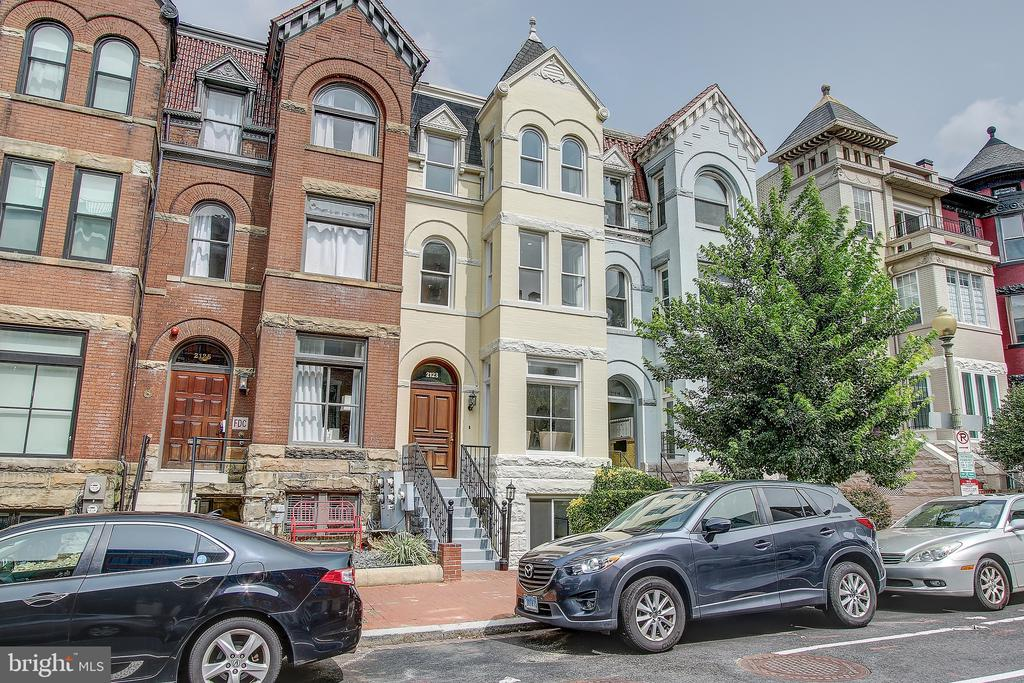 Distinctive c. 1920, four-level historic row house in coveted West End. The residence offers more than 4,100 interior square feet plus a rooftop deck and two off-street parking spaces. A separate lower-level unit with its own C of O is an ideal rental apartment, AirBnb, or in-law/au pair suite. Just steps to two Metro stations, Whole Foods, Trader Joe's, World Bank/IMF, DuPont Circle & Georgetown, and some of the best shopping and dining in the city. With tall ceilings, hardwood floors, tons of natural light, and five fireplaces, this is a special offering.
