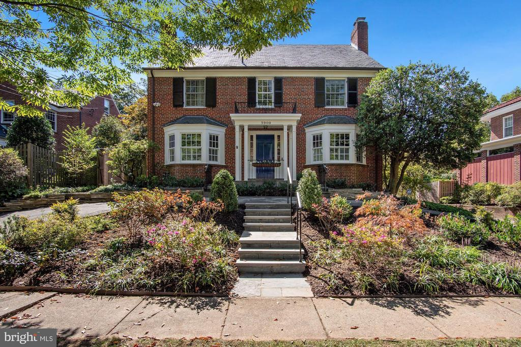 Picture perfect center hall colonial with five bedrooms, four full baths and one half-bath located on a very popular street in coveted Friendship Heights location.  Unique circular drive offers easy access with landscaped front garden, bay windows and covered front porch.  The main level includes a spacious living room with woodburning fireplace, an open kitchen/breakfast room combination, a dining room and a powder room.  Offering terrific flow for casual or formal entertaining including divine covered porch, rear deck and lush rear garden.  Upstairs on the second floor you will find two bedrooms with a hall bath and a beautiful primary bedroom with en-suite bath.  The third level includes another bedroom and full bath as well as ample storage and an office nook.  The fully finished lower level offers a g lovely family room, an office, and another bedroom with a full bath and a generous laundry/utility room.