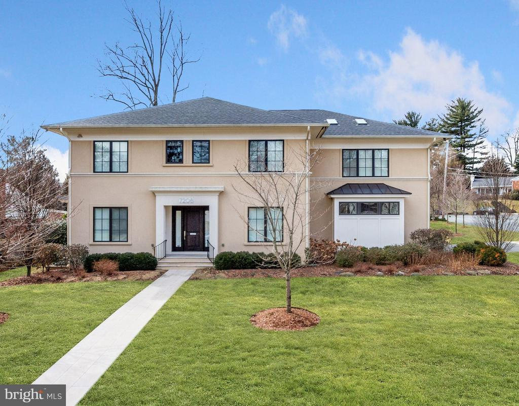 This Custom-designed home built by Sandy Spring Designers, GTM architects is located on a large corner lot in the Kenwood Park area of Bethesda. This stunning contemporary features beautiful modern details and finishes throughout the open floor plan and spectacular outside spaces making entertaining and daily living a breeze. Enjoy cooking for family and friends in the highly functional gourmet kitchen with a breakfast area, two oversized islands, Thermador stainless steel appliances, two sinks, and a butler's pantry. The elegant living room features a modern polished concrete gas fireplace and opens up to the patio through 3 sets of French doors. The formal dining room, office, and mudroom with garage access round out the main level. On the upper level, the primary bedroom has a spacious walk-in closet with covered built-in glass cabinets while the primary bath is a luxurious retreat with a soaking tub, separate shower, and double vanity. Three spacious ensuite bedrooms all with walk-in closets are located on the upper level, as well as a bright and airy flex space that is perfect for a study, work area, or playroom. The lower level continues to impress, offering a family room with a fireplace and wet bar, home gym, and a guest suite ideal for in-laws/au-pairs. Outside will easily become your favorite place with the spacious screened-in porch, expansive Indiana limestone patio, and manicured backyard. Enjoy the outstanding location just a few blocks to downtown Bethesda with a booming restaurant scene, local shopping, and entertainment options.