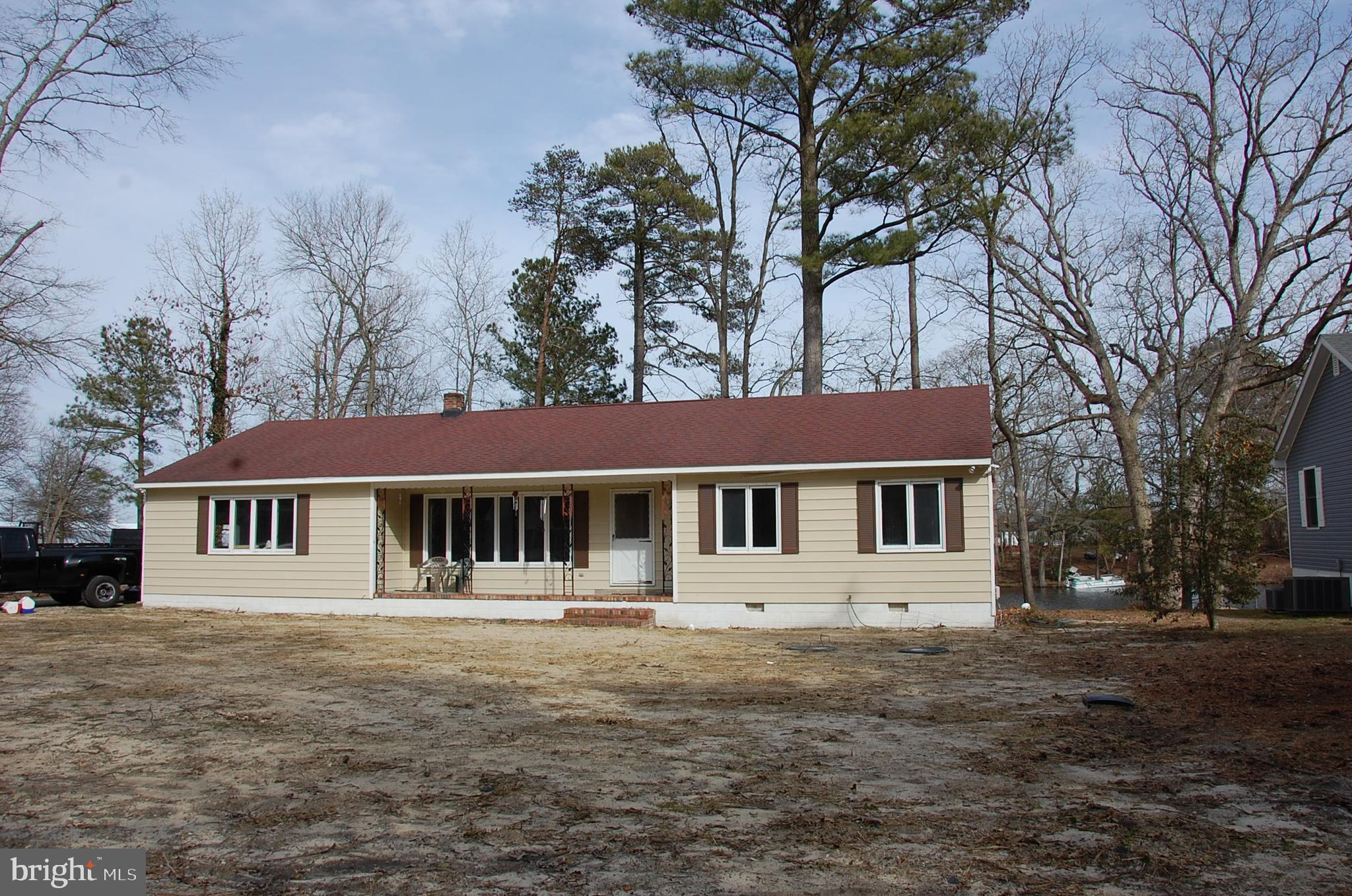 Waterfront home on Horsey Pond,  just West of Laurel.  This 3 bedroom 1 and a half bathroom, 1600 square foot home with a 1 car attached garage. All new well and septic systems.