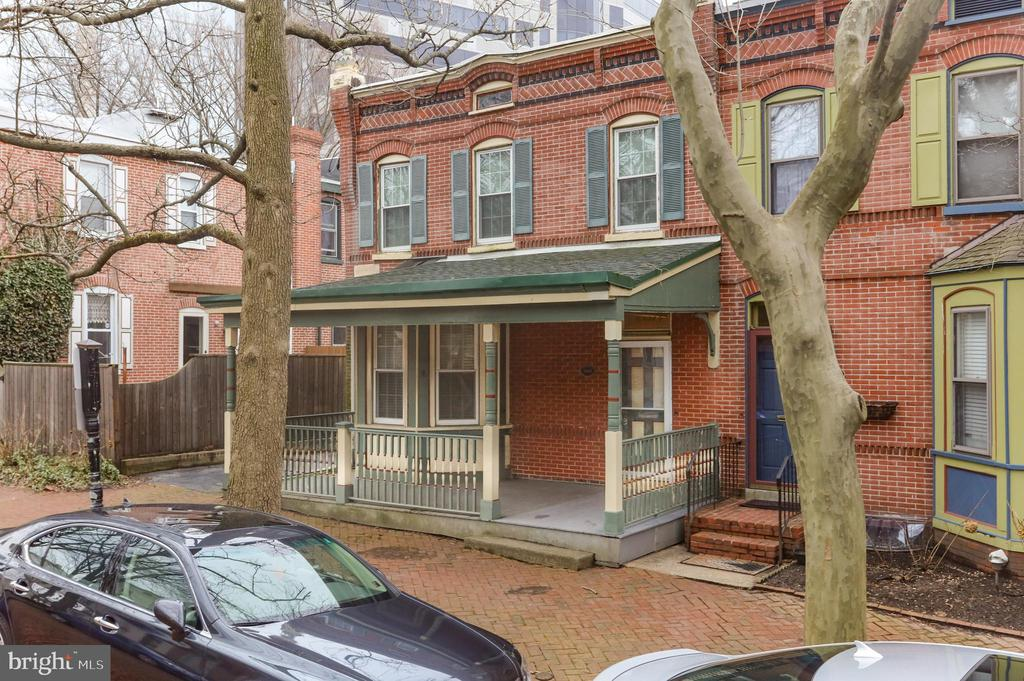 Here is your opportunity to own the only house on Trenton Place that has a driveway for 3 off-street parking spots. Built in 1885, the Rice house is located on an enchanted brick paved street in the historic Trinity Vicinity. This 3 bedroom, 1.5 bath showcases Victorian charm with a blend of modern amenities. The main level consists of a spacious living room with hardwood floors running through the French glass doors and into the traditional dining room. The kitchen has been updated with wooden Ikea cabinets, corian counter-tops, and the must have gas cooking. There is a half bath and a bonus 3 season room off the back with direct access to the driveway. Hardwoods lead up the stairs throughout the second level which is highlighted by an updated tile bathroom featuring a shower stall with glass doors and a soaking bath-tub. Gas heat, fresh paint, replacement windows, and a full basement with laundry, sump pump, and storage complete the package. Ideally located a few steps to downtown Wilmington, walking distance to Trolley Square, and easy access to I-95 and the Amtrak station.