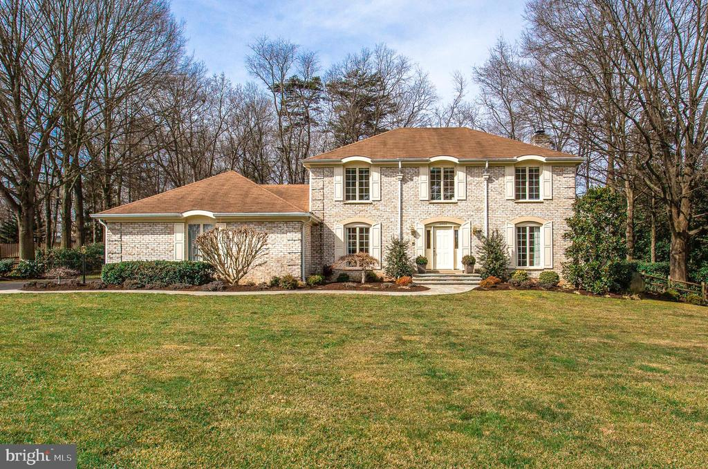 Welcome to your Private Retreat in sought-after Berryland Farm in Oakton!   Tucked away on a peaceful cul-de-sac yet convenient to Tysons, Reston, Amazon HQ & DC.   Stunning colonial home with so many upgrades and beautifully landscaped grounds including a manicured lawn with an inground sprinkler system and low maintenance plantings to appreciate all of natures seasons.  You will love spending time outdoors with ample space to socially distance and enjoy the inground custom designed heated swimming pool and year-round hot tub!  Relax in the sizeable screen-porch with skylights and wired speakers, large deck or pool patio while enjoying the premium treed view.  This home artfully balances entertaining and casual living from its impressive slate front walkway to the 3-car garage that has been wired for an electric car charger.  You will feel welcome as soon as you step into the foyer of this 4-bedroom plus office/den remodeled center-hall colonial.   The updated kitchen with 42-inch white cabinetry, stainless steel appliances with center island cooktop, modern counters & backsplash is sure to please any chef.  The kitchen opens to a casual dining area leading to the screen porch and to the impressive family room.   The family room has custom built-in cabinets and shelving surrounding a gas (propane) fireplace with a wall of windows and French doors leading to the pool.   This room is open to the sun-filled living room which provides a great space for large gatherings yet there are pocket doors between the rooms to create a separate space for learning, working, or playing.  The formal dining room is sure to host many memorable gatherings. You will appreciate the sizeable mud room located between the garage and kitchen with lots of additional cabinetry, coat closet and extra refrigerator.  There is an updated half bathroom with pedestal sink on the main level.   This level includes all hardwood floors, crown molding & recessed lighting.  The upper level has 4-Bedrooms including a large primary bedroom with a walk-in closet and fully remodeled primary bathroom with dual sinks, grand marble tile multi-head shower, soaking tub, & sky lights.  The additional 3 Bedrooms are spacious with ample closet space.   The renovated hall bathroom with modern large black tile floor and white subway tile tub/shower has a large cabinet/countertop. The laundry is also conveniently located on this level.   The fully finished lower level has a large recreation room, updated full bathroom with tub/shower, quiet home office/den, separate exercise room, hobby room and mechanical/storage area.   For peace of mind, there is a house generator that will ensure that work will continue even in the rare storm.  The owners have remodeled and updated most of the home making it move-in ready.   The Berryland Farm neighborhood is known for its close-knit community and beautiful common grounds (two playgrounds, multiple tennis and pickle-ball courts, walking/jogging trails & more!)  and it is in the sought-after Flint Hill Elementary, Thoreau Middle and Madison High School pyramid.   This home has the space, features and location that you will LOVE!   Welcome Home!    Virtual Tour: https://my.matterport.com/show/?m=MW3KQaBHxVw  Open House Sunday March 14 from 1-3PM