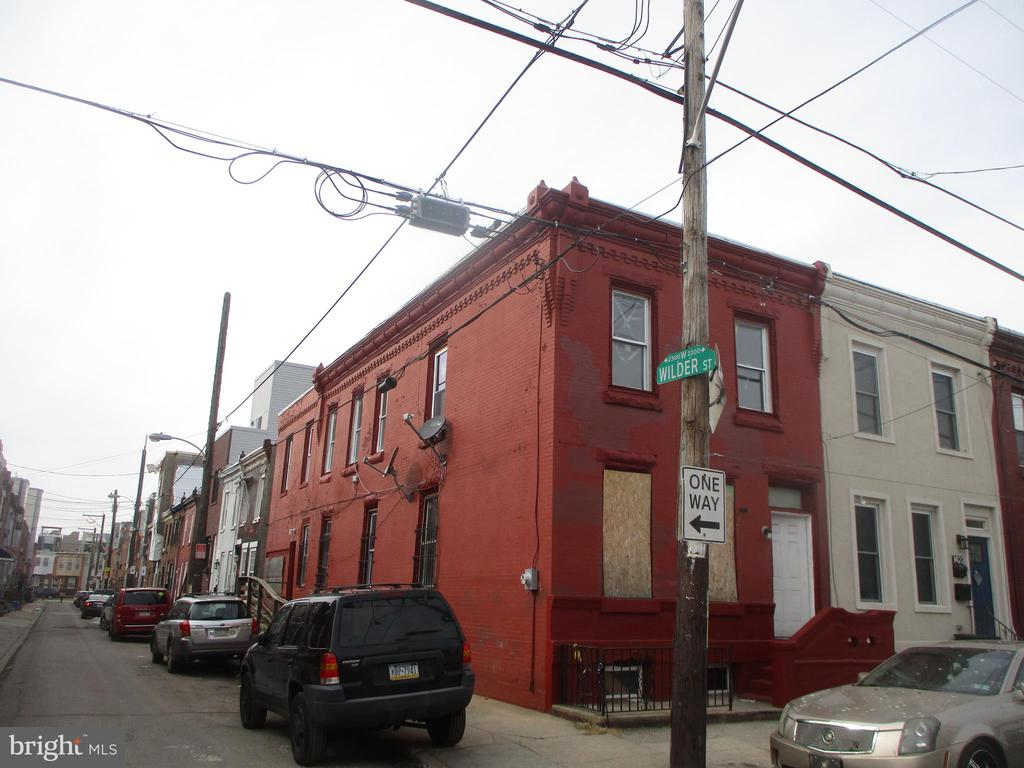 Corner property brightened with natural light by 15 windows. Side garage entry and additional side passage entry with ramp access. With your repairs and remodeling you can restore this home to its full potential. Neighboring homes are adding roof decks and finished basements / possibly you could do the same.