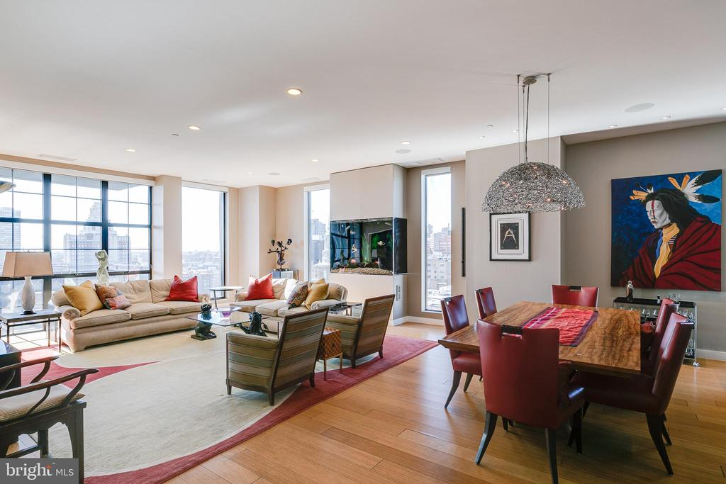 An absolutely stunning 3 bedroom, 3 bathroom condo at Old City's 108 Arch Street Condominium, an exquisite 30 unit boutique building with luxury finishes and amenities throughout. Unit 1002 has a private elevator entrance and is an amazing single-floor unit that spans 2517 square feet and features 3 large beds, 3 full baths, a fish tank, a large private patio, a parking space and amazing natural light with stunning views of the Delaware River, the Benjamin Franklin Bridge, Center City skylines and practically 360 degree views of the city. You enter your unit through the high speed elevator into an expansive foyer. You immediately notice the 10' ceilings, gorgeous bamboo floors, and amazing natural light pouring in through the floor-to-ceiling windows. The foyer leads you to the open floor plan with a massive living room featuring a lovely fish tank (formally a fireplace that can be converted back). The living room opens up to a large dining area with a beautiful chandelier and your large and contemporary kitchen featuring Viking Gas stove, double Fisher & Paykel dishwashers, Sub Zero fridge and a large Viking wine fridge as well as an oversized island, pantry and range hood. The living room also provides access to your south-facing private patio allowing for fresh air and outdoor entertaining! The first of the 3 bedrooms is extremely spacious and offers views of the Delaware River and is currently set up as an office/study. The full hall bath has luxurious and modern finishes, including floor-to-ceiling tile and a stand-up shower stall with a glass shower door. Across the foyer you will find two hall closets and a laundry room with cabinetry. The guest bedroom overlooks the Benjamin Franklin Bridge and is spacious, offering a reach-in closet, an en-suite bathroom with single vanity, soaking tub and floor-to-ceiling tile. The primary bedroom offers amazing light coming with west and north facing exposures featuring views of the Benjamin Franklin Bridge and Center City skyline. The large bedroom also features a large walk-in closet with custom closet treatments. The 5-piece en-suite bathroom is massive and features an oversized double vanity, a soaking tub, a stand-up shower stall with waterfall shower head,  floor-to-ceiling tile, a toilet closet and a linen closet. Nestled in the heart of historic Old City, this condo is surrounded by some of the area's best restaurants, nightlife and attractions. The famous Elfreth's Alley is only a block away, Race Street Pier is under a 10 minute walk, and it is extremely accessible to the Benjamin Franklin Bridge, I-95 to get in and out of the city. A concierge staff is on site Monday through Sunday for additional convenience. All square footage numbers are approximate and should be verified by the buyer.  It is the responsibility of the buyer to verify real estate taxes.