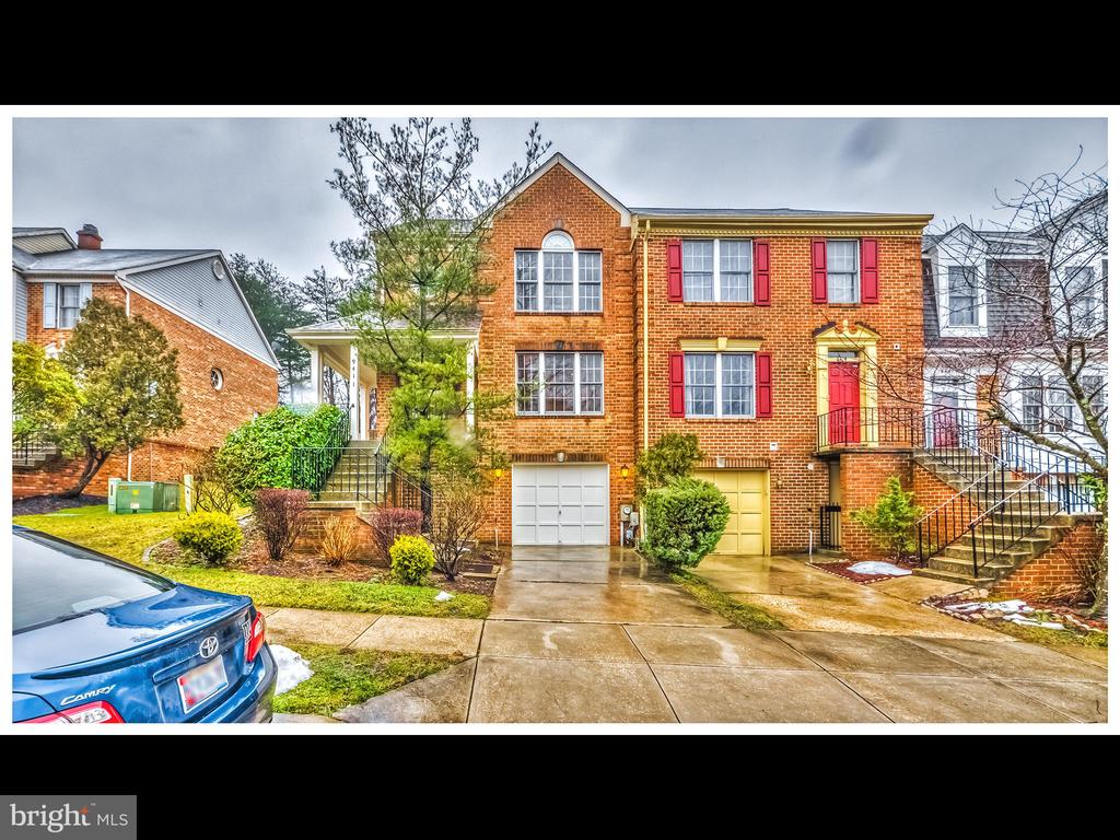 Welcome home to 9411 Rosmarin Way! This beautiful end of unit townhome features 3 beds, 2.5 baths, one car garage, rear deck and so much more! As you enter the home you immediately notice gleaming natural light from all angles of this end unit.  The spacious living room with a wood burning fireplace is the perfect place to relax. Moving toward the rear of the floor you have a half bath and sizable laundry room.  The open concept chef's kitchen / dining room contains modern amenities such as stainless steel appliances and gorgeous countertop.  Opening the sliding door to the outside you're greeted with a large TREX deck, perfect for entertaining, grilling in the summer or just enjoying a morning cup of coffee.  As you descend to the lower level you have a large space that can be utilized as a secondary living room, kid's play area, office, or many other options.  The front of this space contains access to the one car garage and utility room with plenty of storage area.  Making your way to the second floor of 9411 Rosmarin you have three bedrooms and two full bathrooms. The master bedroom contains a well suited walk in closet and a recently updated, high end master bathroom with soaking tub, his/her vanity, and custom shower.  Come enjoy the gorgeous summer weather at your new home, 9411 Rosmarin Way! Do not miss out!! **UPGRADES: HVAV 2015 / Roof 2019 / Deck 2018 / Master Bath 2021 **