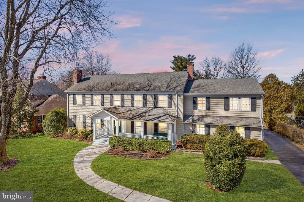 Welcome to 11108 Luxmanor Road, sited on a premium half-acre lot, this classic colonial showcases modern elegance in an open and expanded living space. The spacious 4,800 square foot home seamlessly combines high-end finishes and modern comforts for an abundance of family living spaces that include a family room addition, mudroom addition, upper-level bedroom suite addition, and screened porch addition. Design touches include an expansive covered front porch, dual bedroom suites, front and back staircases, custom built-ins, gleaming hardwood floors, recessed lighting, crown molding, and oversized windows letting in tons of natural light. One of the many highlights of the home is its expansive backyard retreat featuring a spacious 3-season screened porch, a covered deck/back porch, and a large, level backyard – perfect for entertaining or relaxing with family. The centrally located gourmet kitchen boasts 42-inch white cabinetry, granite countertops, contemporary tile floors, and an eat-in breakfast room framed by a large bay window. The family room addition offers a brick surround fireplace, a wall of windows facing the backyard, and a glass door exiting to the back deck/porch. A formal living room with built-in bookcases (2nd fireplace behind built-in if buyers elect to uncover), a formal dining room opening to the screened porch, a mudroom/laundry room with garage access, a back staircase, and a powder room, can also be found on the main level. The upper level provides 3 full bathrooms and 5 bedrooms including two suites. **Hardwood floors under the carpet on most of the upper level** The spacious owner's suite features two walk-in closets (including a huge 100 sq ft walk-in) and a newly renovated spa-like bathroom with a Restoration Hardware marble vanity, oversized glass door shower with dual shower heads, and designer tile finishes throughout. The 2nd suite offers an attached bathroom and private access to the back staircase - ideal for an au pair, guest suite, or office. The finished lower level provides an abundance of space for a rec room/game room, exercise room, and additional storage. Convenient attached garage plus a recently added detached 2-car garage. NEW furnace (2018), NEW hot water heater (2018).  Ideally located on a quiet street off of Tilden Lane, minutes to neighborhood parks and pools, and walking distance to Pike & Rose outdoor shopping and entertainment complex. Perfect for commuters with easy access to I-495, I-270, Grosvenor, and White Flint Metros. Top-rated MOCO school district. Don't miss this amazing home!