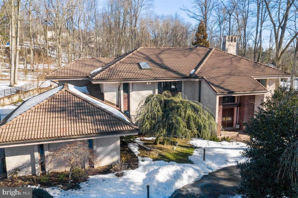 Don't miss the opportunity to show this absolutely stunning, elegant, sophisticated and updated custom home situated on one of the most beautiful and sought after cut-de-sac locations in Bryn Mawr.   You will appreciate the unique and special character of this amazing home, the minute you enter the spectacular, grand, 2 story entry foyer which is bathed in natural light and features a stunning crystal chandelier, marble floors and designer accented curved staircase.  Step down to the impressive great room that is a perfect gathering place for entertaining.  Gather around the gorgeous fireplace that includes a granite surround and granite raised hearth.  The chef of the house will appreciate the fabulously well appointed gourmet kitchen with beautiful granite counters,  oversize island, 2 sinks, gas cook-top and an abundance of imported custom Siematic cabinetry.  The sunny and spacious breakfast area offers a greenhouse window along with sliding doors that lead to a spectacular screened porch  that was recently added.  The sunroom overlooks the incredible grounds and offers high ceilings and walls of windows.   On the upper level, the primary bedroom is spacious and luxurious, featuring a sitting room/office, large bedroom with a fireplace, dressing area and 2 large walk-in closets.  That marble bathroom has 2 Siematic vanities and cabinetry, jacuzzi tub over sized shower.  There are 3 additional well proportioned bedrooms and 2 new full bathrooms on this level.  The lower level is finished and includes an additional bedroom with proper egress, along with a full bath and work-out room and game room.  For the wine enthusiast, there is a large wine cellar.  When you step outside, you will want to vacation at home!  Magnificent gardens, beautiful swimming pool and expansive patio with fire pit add to the charm and appeal.  This almost 1.5 acre property is truly unique and special.  You will not want to miss the chance to call it home!