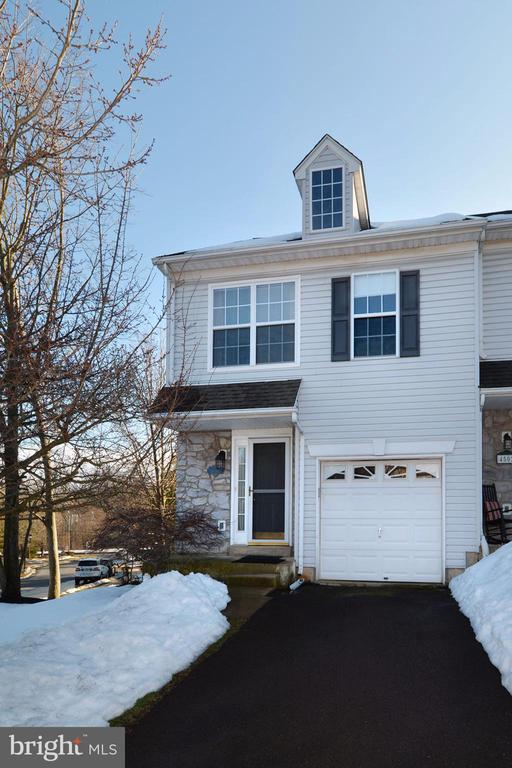 Welcome to beautiful Patriots Ridge community, End unit 3 bedroom 2 1/2 bathroom townhouse with one garage in Doylestown. Sun filled living room and dining room with sliding glass doors leading to deck with mature landscaping. Kitchen is centrally located. Beautiful hardwood floors throughout. Upstairs are 3 bedrooms. Large Master bedroom with walk in closet, Masterbath room has been renovated. Upper level laundry. Finished walk out basement has a family room with a fireplace with sliding glass doors leads to patio. Extra storage room in basement. Move in and still enjoy summer as the unit is available immediately. Close to downtown Doylestown and easy to access to Route313, 611 , 263 and 202