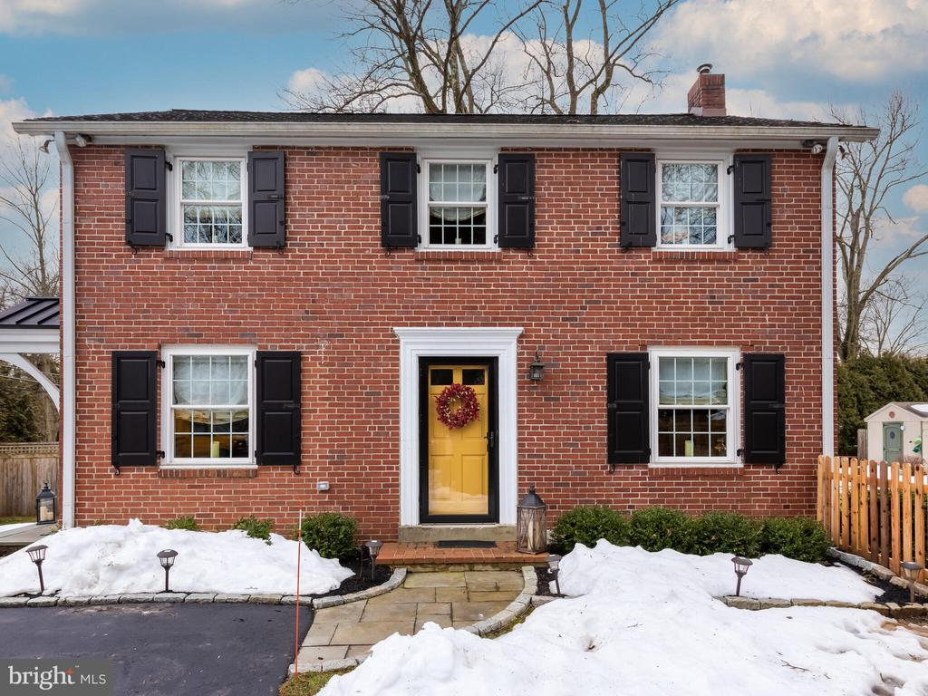 Welcome to 348 Upper Gulph Road, a move-in ready brick colonial home that has been beautifully updated and expanded. The living space square footage listed in the tax records is not accurate due to the expansion of the first floor foyer and kitchen created by very proud homeowners. The home is situated on a unique double lot with access to Upper Gulph Road that includes a driveway with parking for several cars.  The property has possible off street parking on Rosedale Avenue which is part of the second adjoining lot. The entire yard area has new fencing that includes solar lighting creating a beautiful ambiance for outdoor enjoyment on warm Spring and Summer evenings. Entering the side door with portico, brings you into the foyer, which includes custom built seating, cubbies, closet, laundry area and powder room. The kitchen was completely renovated and expanded featuring granite countertops, bar area with wine rack and under counter Maytag ice machine.  There is a center granite island providing seating for dining and entertainment.  The island has two deep drawers and cabinet with pull out for a stand mixer.  Appliances include stainless steel Electrolux stove with direct outdoor vent, Electrolux French door refrigerator and new GE dishwasher.  The farm sink is directly under the window overlooking the deck and backyard.  Kitchen cabinets on both sides of refrigerator are floor to ceiling providing lots of storage.  The living and dining areas feature original hardwood flooring that has been refinished, crown moldings and wainscoting in dining room.  There is direct access to the large deck from the dining room which takes you to the large backyard that has possibilities for a pool or future expansion.  There is also direct access to Rosedale Avenue. The second floor features three bedrooms that includes a newly renovated master with the addition of a master bath with heated flooring.  The main hall bath was completely renovated with new tile flooring and fixtures