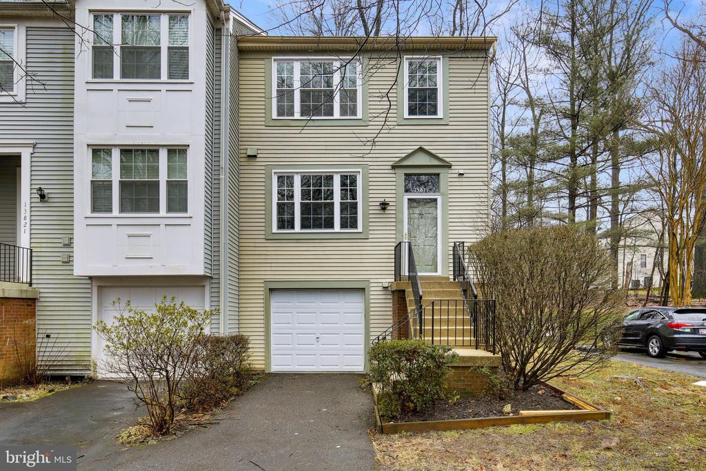 Don't miss an amazing opportunity to own one of the best townhomes in the desirable Potomac Ridge neighborhood. Recently updated with hardwood floors on the main level and a fresh coat of paint all throughout, this home is what you've been waiting for. Adorned with an ample amount of natural light, the home welcomes you with the warmth of the northwestern sunlight. This model comes with a one-car garage, and due to the length of the driveway, it can adequately fit an additional two cars - there is also plenty of parking throughout the neighborhood for all future gatherings! Double glazed windows, screen doors, and patio doors were all replaced within the last four years making it quite efficient to keep in the warmth for the winter, and the cool for the hot summer days. Upstairs, skylight and vaulted ceilings continue to make the home feel open and airy. Within the large owner's suite, the bathroom has been updated with new tile, shower glass door, toilet, and vanity. After enjoying the views of the inside, you can walk out to a beautiful private oasis in the backyard. Serene and tranquil, with views of the woods, the private and fully fenced brick patio will help relax the body and mind on any given day. A newly built playground only steps away from your front door, basketball courts, soccer fields, tennis courts, numerous tot lots, trails, and bike paths are all available within this vibrant neighborhood. Again, don't miss the opportunity to acquire an amazing end-unit within the highly rated school district.