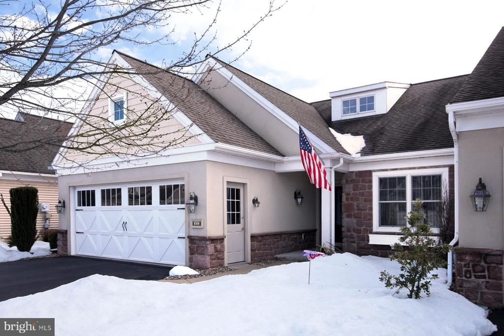 "Living is easy in this 2-bedroom 2 bath end unit villa with open floor plan. Some of the features that set this home apart are the spacious living room with cathedral ceilings, hardwood floors and 3 sided fireplace, The primary bedroom includes walk in closet, master bath with double bowl vanity and convenient easily accessible shower. You will appreciate the warmth and the light streaming in from the south side patio doors. The full front screen door creates a nice cross draft to the patio door. The kitchen has a new tile backsplash and includes dishwasher, microwave, range and disposal. in addition to the step saving layout, you will enjoy the energy efficient gas furnace and gas hot water heater. Downsizing does not mean giving up on your fun. Join the community center and you have access to an indoor pool, hot tub, billiards, fitness room. hairdresser, library, puzzles, games, community events, fishing and more...The land lease and HOA cover land tax, trash, snow removal to the door (2""or more) lawn maintenance, on site management and common are maintenance. So, what are you waiting for?"