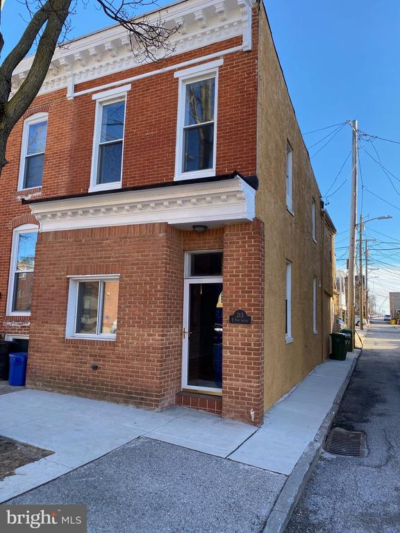 JUST WHAT YOU HAVE BEEN WAITING FOR!  Beautiful large & wide 2 Bed/ 2.5 Bath Federal Hill End of Group Townhouse.  This brick front unit w/ bump out features a unique open concept when you walk in that allows for the perfect flow for entertainment & 9' Primary BR & 1st floor ceiling height.  Home features, hardwood flooring, gourmet kitchen w/ granite top & island, new SS appliances, recessed lights, exposed brick walls, primary bath w/ the hard to find modern shower panel and sprays, new carpeting, large tall windows for lots of natural light, new stacked washer & dryer, CAC, ceiling fans, freshly painted, jetted hall tub and much more.  Second level has bonus walk out deck from 2nd BR with space to  sit out chairs and enjoy the views on those warm summer nights.  Unfinished basement has room for lots of storage.  Enjoy the beauty and green space of Riverside Park, which is just 1 block away, walking distance to shops, bars & restaurants, Juice Bar & Coffee Shops!  Short drive to downtown, Inner Harbor, Ravens & Orioles Stadium, Horseshoe Casino and I-95.  YOU COULD NOT ASK FOR A BETTER LOCATION!  Come Enjoy Life in this Federal Hill/Riverside community.  Hurry as this rare opportunity will not last long. CURRENTLY, NO FHA FINANCING DUE TO THE 91 DAY FLIP RULE!  ALL OFFERS WILL BE PRESENTED ON SUNDAY, 3/7/21 AT 7PM AND A FINAL DECISION WILL BE MADE THEN.  Priced slightly below the appraisal to sell fast and seller wants to close quickly.  Call LA with questions and to schedule an appt.