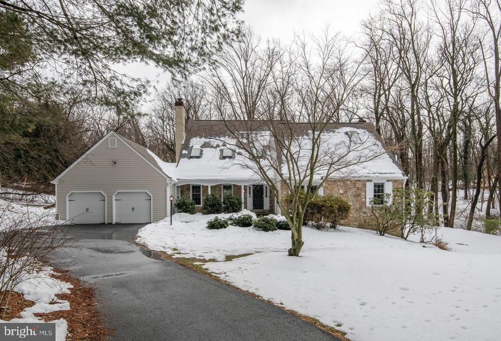 Four bedroom, 2 and a half bath custom Cape Cod on  quiet cul-de-sac,  set on 1.18 acres of secluded, partially wooded property in beautiful Bryn Mawr, in award winning Radnor School District . Available for a quick settlement! All new exterior - siding, roof, windows, gutters/downspouts and skylights replaced in 2020.  Long driveway with gorgeous, lush landscaping, full trees, and even a babbling brook out back, sprawling yards in front, side and back. Enter through the covered porch to a grand foyer with vaulted ceilings. Formal living room with  hardwood floors and wood-burning fireplace adjoins large dining room with dramatic chandelier. The expansive kitchen has excellent cabinet and counter space and is fully outfitted with updated stainless appliances and a center island. Take in the natural light and breathtaking views of the serene back yard and deck areas from just about every room. Great family room off of the kitchen with tall built-ins, vaulted ceiling and wood burning fire place, and flows to the rear outdoor space. The main floor is rounded out with the Master suite, complete with dressing area, ample closets and a huge custom master bathroom. Upstairs, find 3 more spacious bedrooms and a full bath with extra attic storage. *Behind the laundry area, there is attic space that can be finished for a 5th bedroom. Owners have installed brand new skylights in preparation to improve this space, which is the size of the 1st floor master bedroom. The lower walk-out basement level is massive and could easily be finished for more square footage or to add an in-law suite, theater, exercise room, or work from home space. Make this dream home a reality today!