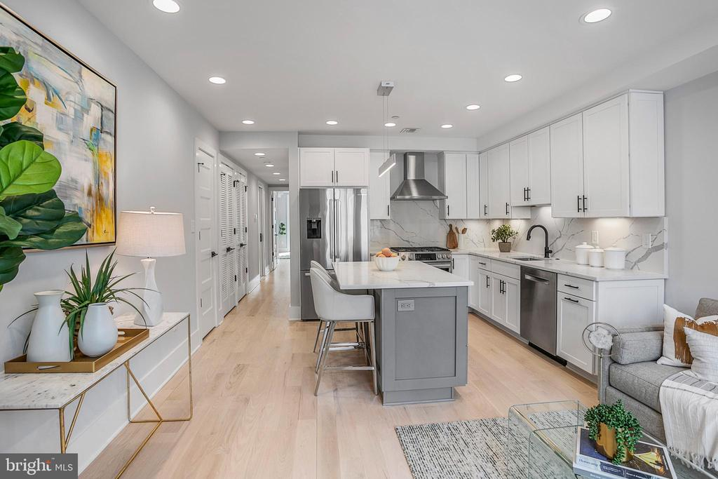 ASK AGENT for stunning 4K video tour. For the full marketing suite, including an HD virtual tour, video Glimpse Tour and property video, please visit: https://poduslogroup.com/2122-o-street-nw-2/ -----Sophistication, style, and elegance converge in this rare opportunity to own one of three newly constructed exemplary homes.  Ideally positioned on the trophy stretch of O Street in the heart of Dupont, this stunning brick federal contemporary masterpiece is designed to impress even the most discerning of homebuyers. Welcome to 2122 O Street Condominiums, offering 3 new expansive condos thoughtfully designed with impeccable finishes and treatments at every angle. Each residence is outfitted with a high-end suite of finishes including stunning kitchens with Calacatta Laza quartz countertops and top tier Bosch appliances, Italian imported Edimax Astor velvet tile bathrooms, and finished in place wide plank oak flooring.  Unit #2 features two bedrooms and two beautifully appointed bathrooms, Trex front porch (LCE), and a rear balcony. Look beyond the finishes and discover countless details that separate this condominium from anything on the market: in-wall sound isolation between rooms and floors, historic grade double glazed windows and doors, and Trex select composite decking with RainEscape drainage system. Separately deeded rear parking available for $50k. An unbeatable location, a near-perfect walk score.