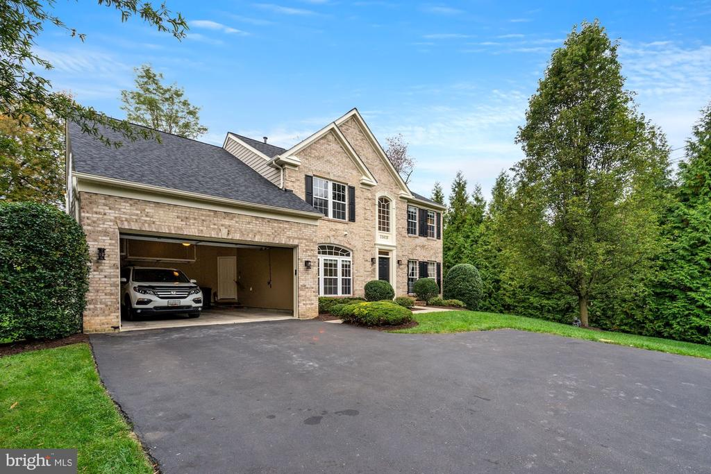 Welcome to this spectacular and rare offering in exclusive Amerlea Farm! This sun-drenched home is updated throughout and move-in ready! This gorgeous home has 5 bedrooms and 4.5 baths and is modern and updated. The main level features a ceramic tile foyer, gleaming hardwood floors throughout the main level featuring an office with French doors, a formal living room, a formal dining room, and a chef's kitchen with granite countertops, an extended island with space for seating, stainless steel appliances, and opens to the family room with cozy fireplace and hi-end MartinLogan speaker system. A mudroom that attaches to the garage and sunroom with views of the treed backyard, complete this level. This corner lot home is private, secure, and set ina serene setting. The upper level hosts a spacious master suite with a tray ceiling, a sitting room, walk-in closet, and an updated attached master bath with a separate tub and shower and his-and-her vanities. Three additional bedrooms and two updated full baths complete this level. The light-filled finished walk-up lower level has an additional bedroom, full bath, recreation space, and a built-in bar. Brand new roof. Location! Close to excellent schools, shopping, parks, trails, Amberlea farm with horses, and major commuter routes!