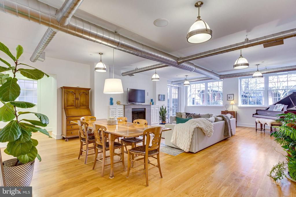 This  2 bedrooms plus private office with built in bookshelves, 2.5 bath apartment feels much more like a single-family home with its large walk-in closet with built in cabinets and private fenced patio with private entrance. It is one of the larger units, at 1840 SF, located in The Landmark Lofts. There are 44  units fully utilizing the building's stunning architecture.  This unique unit features 11-foot ceilings, exposed brick and a wall of windows with streaming light all day long. It has top of the line finishes that include granite counter tops, cherry cabinets, Wolf range and Subzero refrigerator. It is pre-wired for internet/cable/FIOS. There is a gas fireplace with polished marble mantle with built in cabinets and Bose surround sound with beautiful hardwood floors throughout. Unique to this unit is a separate laundry room.   The living room, dining area & kitchen have a spectacular four season view through large oversized windows. French doors lead to large patio with room for table, chairs, grill and private access. The location of this unit makes easy access to enter or exit the complex without the use of an elevator or stairs. Because it faces the interior of the complex, it is extremely quiet. Features a  utility closet next to the unit, 2  garage parking spaces,  storage unit & a  secure temperature/ humidity controlled 30 bottle wine storage locker that is located in a private tasting room.  This multi-secure condominium 24/7 concierge and secure gated entrance. Amenities include clubhouse, movie room, fitness center, roof top pool, secure package room and dry-cleaning pickup and delivery service. Landmark Lofts is pet friendly and located near many children's playgrounds and dog parks.  The vibrant H Street Corridor has all the urban attractions that make this neighborhood so exciting. Near by shops include: Whole Foods, Giant, Harris Teeter, Trader Joe's and the Union Market with restaurants and shopping all within blocks.   It is just 300 yards to U