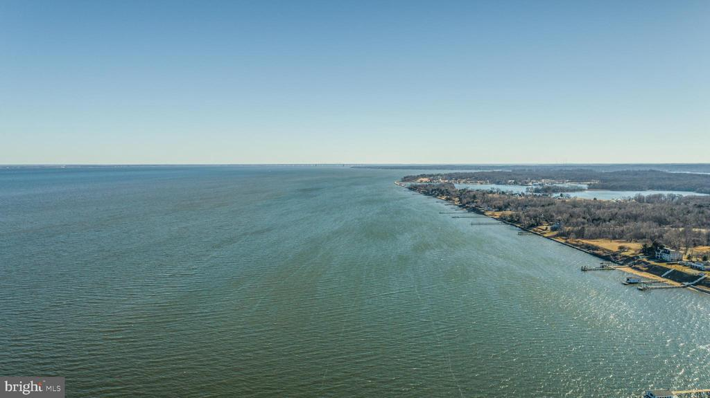 Sweeping panoramic views abound from this stunning Bay front property with 160 ft of Chesapeake Bay water frontage.  Sit back and watch the ships go by from this ultra private setting, enjoy dazzling sunrises and savor the picturesque views from this elevated 1.11 acre vista.  Lot perc'd for 3,500+ SQFT HOME.   The existing cottage features a large office, bdrm, full bath plus a massive screened in porch.  The existing building footprint is very large and this would be the perfect location to construct a new custom waterfront residence.  No need for flood insurance, this property sits at just the right elevation plus the entire shoreline is protected with commercial grade riprap.  Gibson Island and Beach Club is just up the street where membership (by invitation only) provides access to the country club, pool, beach, tennis, deep water marina, award-winning Charles Blair Macdonald designed 9-hole golf course, swimming, croquet, skeet shooting, and more.  This property provides the perfect location for quick access to hiking and biking in Downs Park, heading over to Gibson Island or jumping on Rt. 100 to get back to Baltimore or Washington, DC.