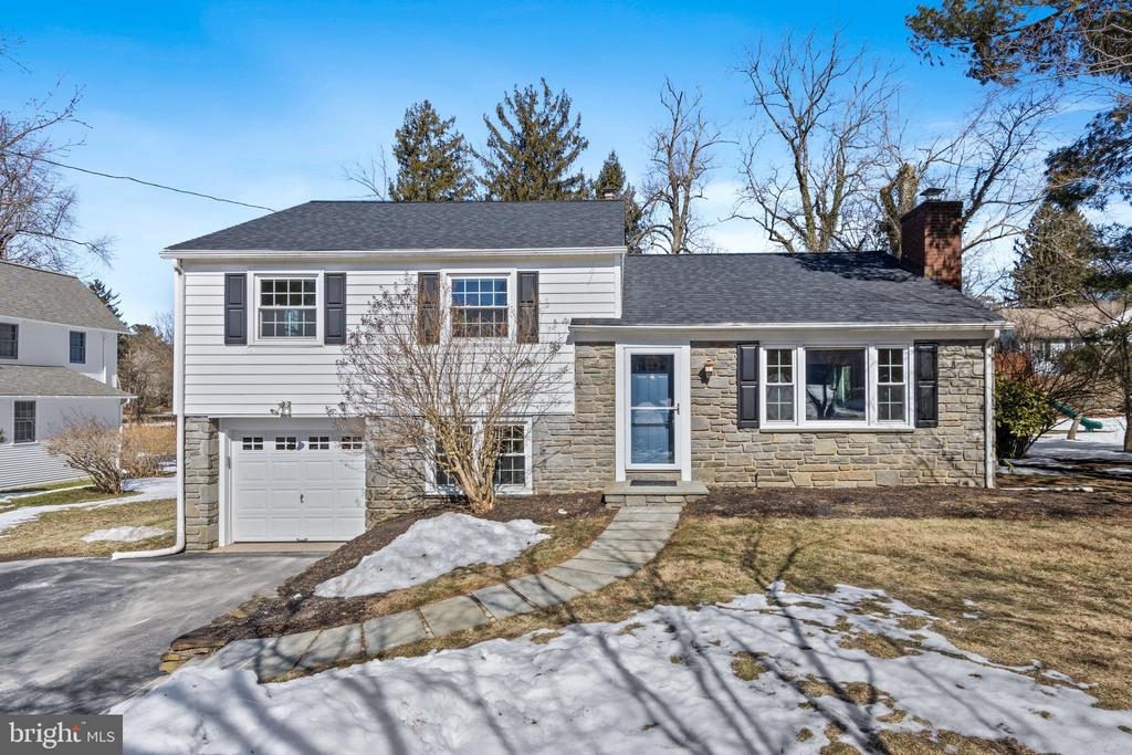 *** https://vimeo.com/518820752 *** Welcome home! This renovated, turnkey home ideally located in a walk-to-Berwyn neighborhood in the top ranked Tredyffrin-Easttown School District will not disappoint! Highlights include freshly painted interior in stylish gray (2021), hand-scraped hardwood floors and recessed lighting on main level, CertainTeed replacement windows and honeycomb cordless shades throughout, beautiful Eat-in Kitchen/Dining Room renovation, NEW hall bath (2018), NEW roof & gutter guards (2019) and NEW gas furnace (2021). You'll love the curb appeal of this split-level home with classic stone and white siding exterior with welcoming flagstone walkway. Enter the home into the Foyer with convenient coat closet and hardwood steps to the upper level. To the right, you'll find the light filled Living Room featuring a wood-burning fireplace with slate surround complimented by a triple window with front yard views. The completely renovated Eat-In Kitchen and Dining Room combination (2015) includes Soapstone countertops, Crown Molding, Wolf Premium cabinetry, Subway Tile backsplash (herringbone accent pattern), large Center Island (with seating and ample storage) and sunny breakfast area with triple window. The ultimate chef's kitchen features all Stainless Steel appliances: 5-burner BlueStar gas cooktop, Miele Speed oven (microwave & convection), Kitchen Aid French door refrigerator, BlueStar French door wall oven, Kitchen Aid warming drawer and GE dishwasher (2021). Door leads to the private patio for outdoor entertaining and enjoying the flat backyard - a great place for playing. From the kitchen, take the half flight of carpeted stairs (elegant lattice pattern) down to the lower level - a flexible space for a Family Room, Playroom or Home Office/Study Area with double window with deep sill and convenient inside access to the 1-car garage. Laundry and Powder Room (both with ceramic tile flooring and windows) plus utility room complete this level. Upstairs you'll find the Master, 2nd and 3rd nicely sized Bedrooms all with hardwood floors. Enjoy the newly remodeled Hall Bath (2018) with seamless glass doored tub/shower with tile surround, ceramic tile floor, furniture-like wood vanity, window and linen closet. The upper and lower walk-up, floored Attics are perfect for storage with the potential to be a 4th Bedroom or Master Suite. More updates include NEW front and rear entry doors (2018), NEW rear storm door (2020), NEW automatic garage door opener/wifi keypad (2019) and Tesla 220 outlet installed (2019). You're just down the street from the shops & restaurants in Berwyn plus the train. Includes 1-Year Supreme Home Warranty - this great home won't last! SHOWINGS START FRIDAY, MARCH 5th