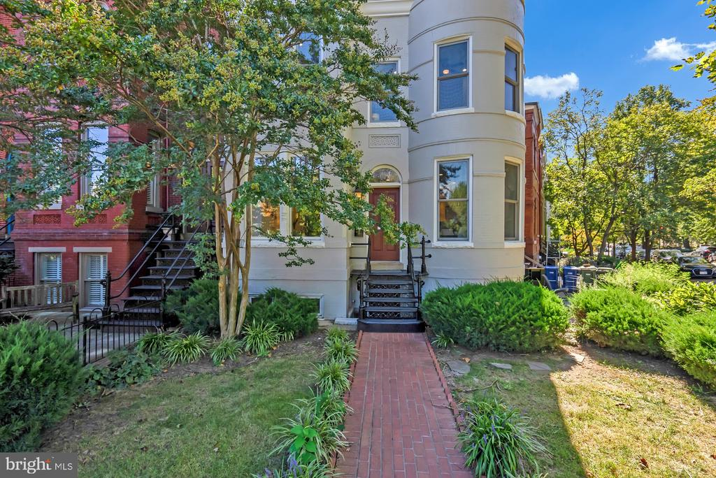 This property is a genuine Capitol Hill Stunner. Don't look any further, you have found your dream home and income producing property! This four level, 3,200 SF row home sits comfortably on the corner of North Carolina and 9th Streets Southeast, just two blocks from Eastern Market. Tend to your oversized, wrap around, enclosed garden out front and enjoy a cup of coffee on your private, primary bedroom balcony. Classic features include hardwood floors throughout, massive kitchen with ample storage space, roomy study/office nook with built-in book shelving and fireplace, timeless finishes, granite countertops, crown molding throughout, new window fittings to maximize efficiency + high-efficiency lights throughout installed Summer 2020, oversized walk in closets with custom built-in storage in all bedrooms, soaking tub in primary bathroom, dual vanities, brand new washer/dryer unit on second floor, don't forget to look up at the massive skylight hovering above the staircase drawing you to your oversized master suite, welcome home! Bonus*** Income producing 1BR/1BA apartment in lower unit, with separate entrance. Sellers rented previously for years at $2,000/month, OR short-term rental savvy buyers can Airbnb for $3,000-$4,000+ a month. This is a legal 2-unit with active C/O, BBL and separately metered spaces. With rates this low, your rental unit can pay 70% of your mortgage!