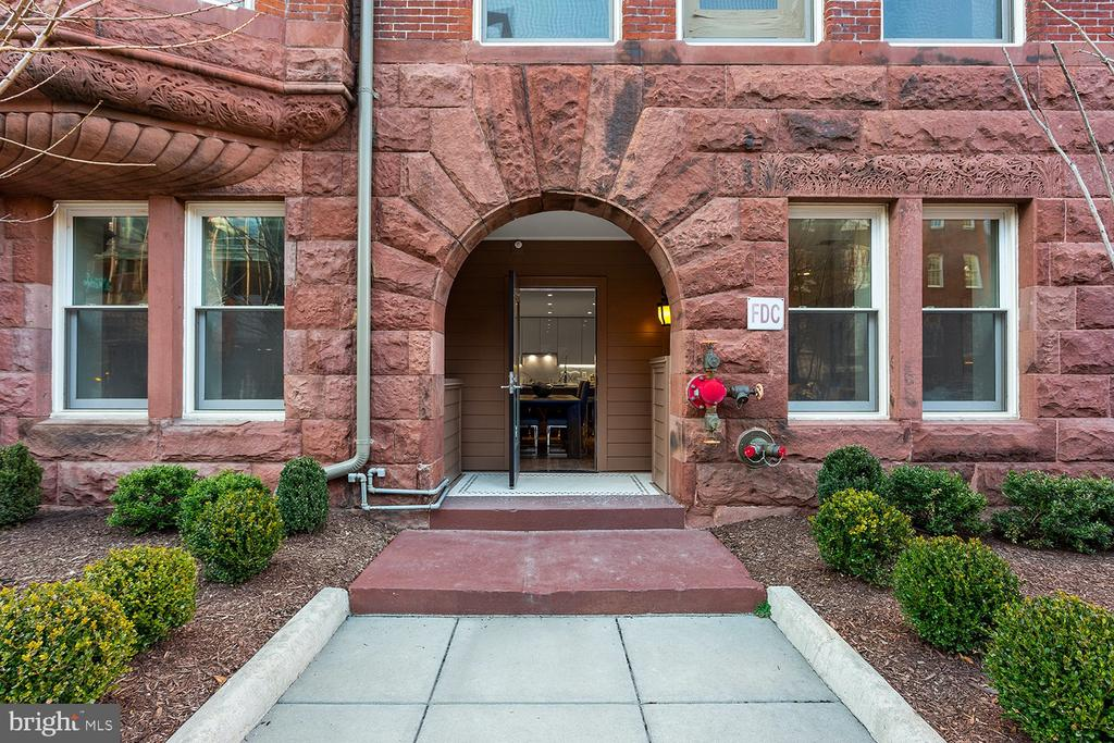 Only a handful remain at this gorgeous community!  #111 at The Historic Row at 1745N is a spacious 2 bedroom with 2.5  baths, and an end residence, too!  Plus, it features two entries including it's own front door to the walk-way and a parking space  is included in its price!   Experience the finer details throughout including stainless steel appliances (gas cooking), wide-plank premium hardwood flooring, custom cabinetry and more. The Historic Row at 1745N offers a concierge, package room, bike room, and courtyard.  Find yourself relaxing in the courtyard.  Let's not forget the location: a tree-lined Dupont Circle street where Iron Gate, Tabard Inn are among the neighbors. Immediate delivery.   Historic charm with modern sensibilities:  The Historic Row at 1745N Dupont.